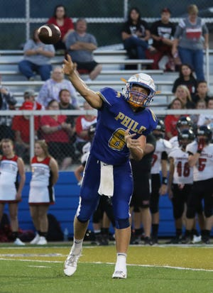 Philo's Hunter Adolph unleashes a pass during a Week 2 win against Crooksville. Adolph is one of the area's top passers in his first year as a starter.