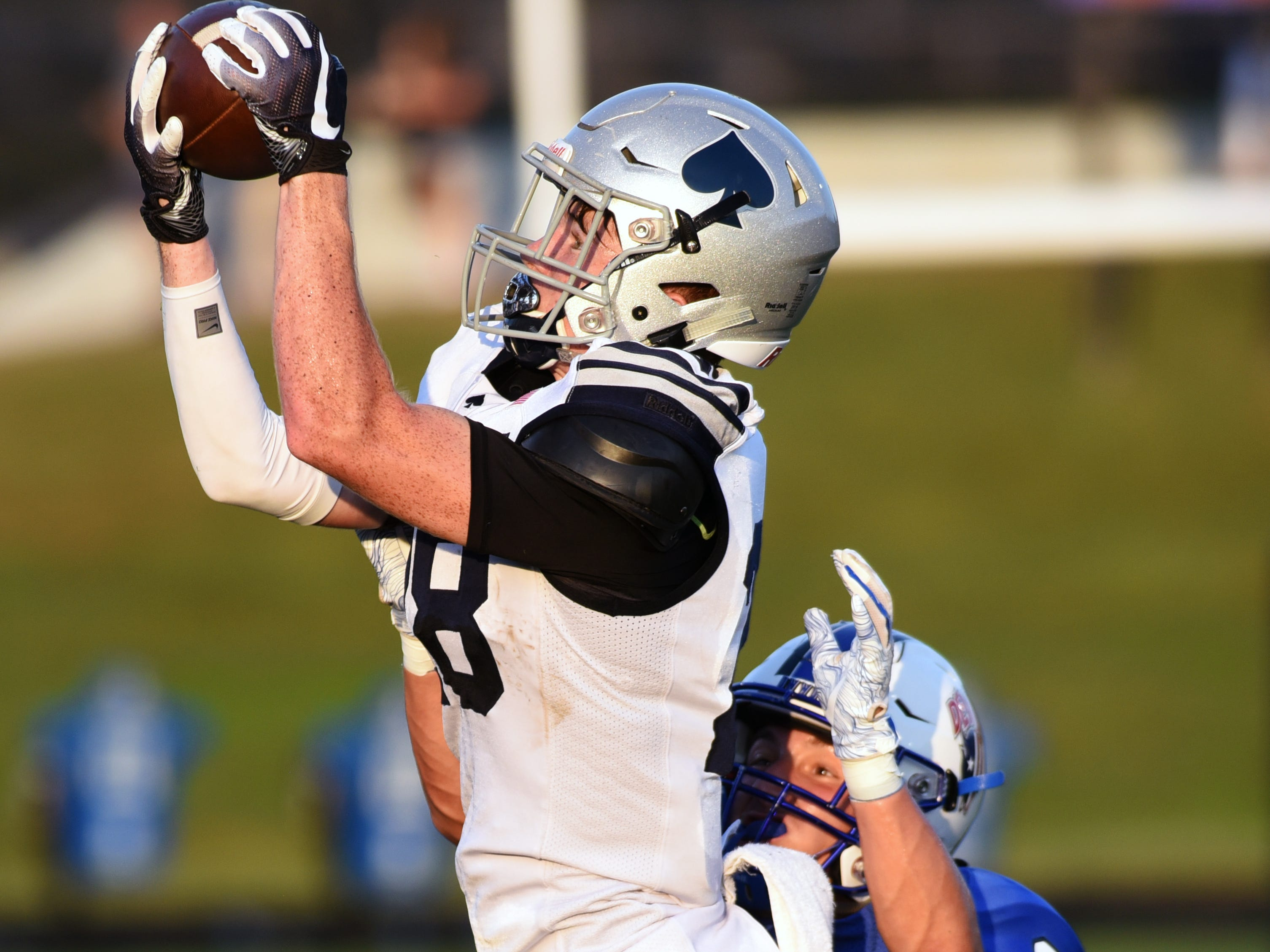 Zach Walsh catches a pass in the first quarter for Granville. The Blue Aces held on for a 17-14 win against Zanesville on Friday night at John D. Sulsberger Memorial Stadium.