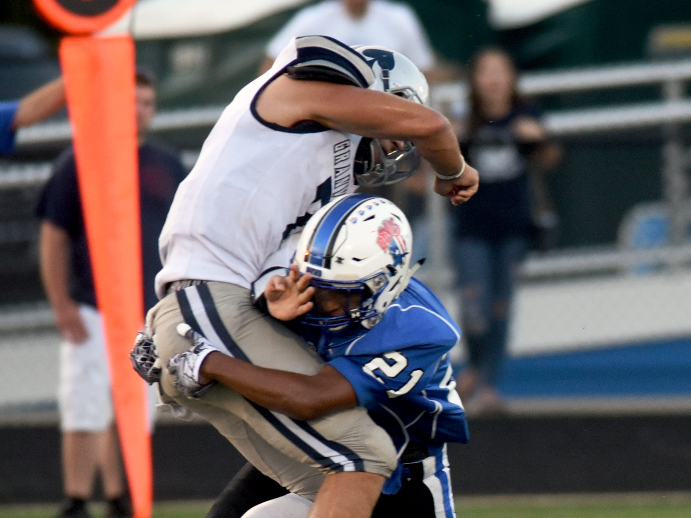 Zanesville's Julius Murphy lays a hit on Cameron Crouch during the second quarter. Granville held on for a 17-14 win on Friday night at John D. Sulsberger Memorial Stadium.