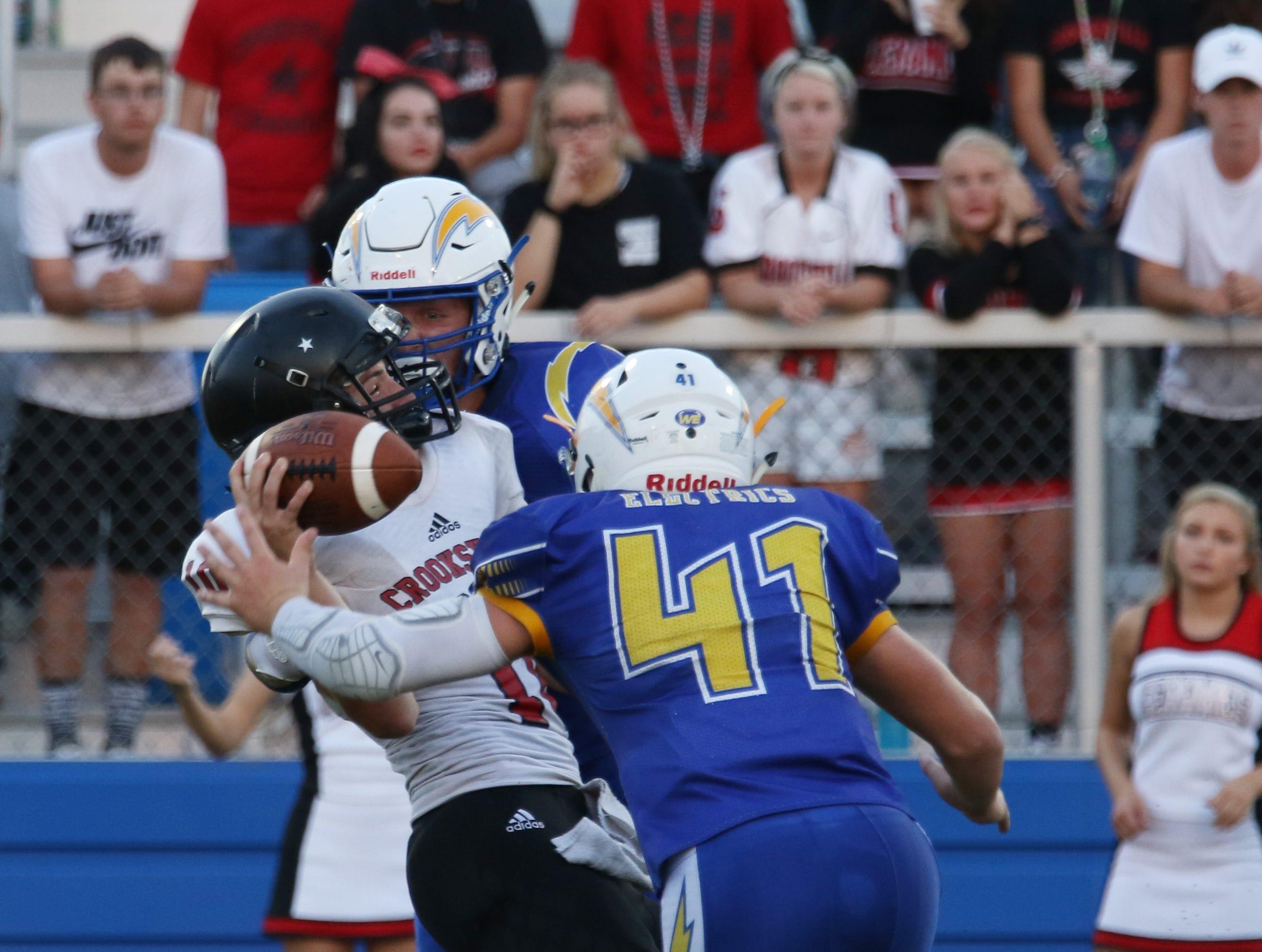 Philo's Brock Luburgh hits Crooksville's Noah Dickerson.