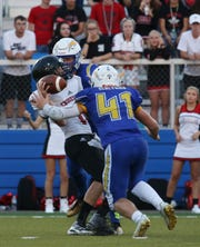 Philo's Brock Luburgh hits Crooksville's Noah Dickerson in a game last season. Luburgh, a middle linebacker, is one of the leaders on the Philo defense.