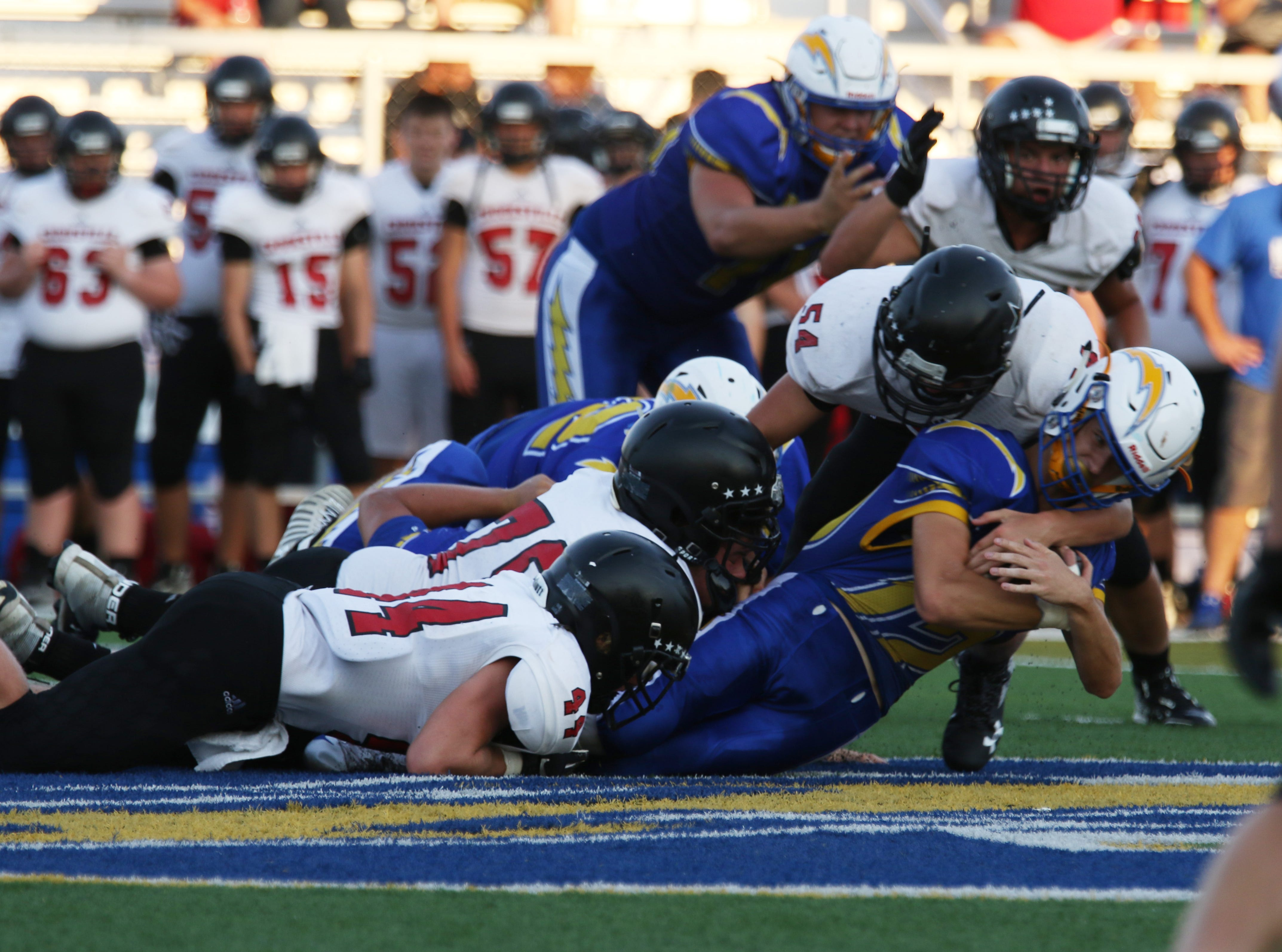 A trio of Crooksville defenders stop a Philo ball carrier.