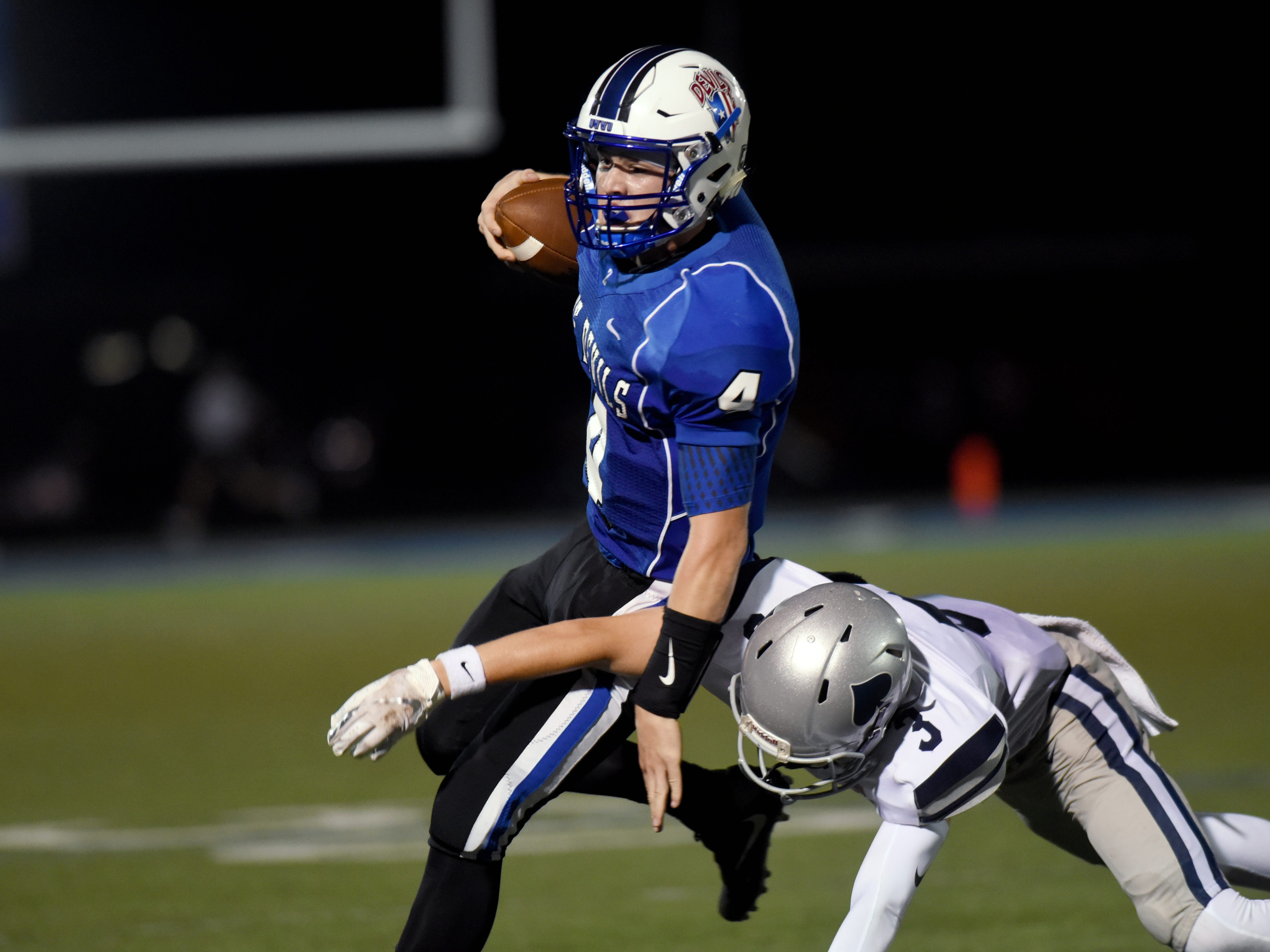 Ben Everson scrambles for a first down during the fourth quarter of Zanesville's 17-14 loss to Granville on Friday night at John D. Sulsberger Memorial Stadium.