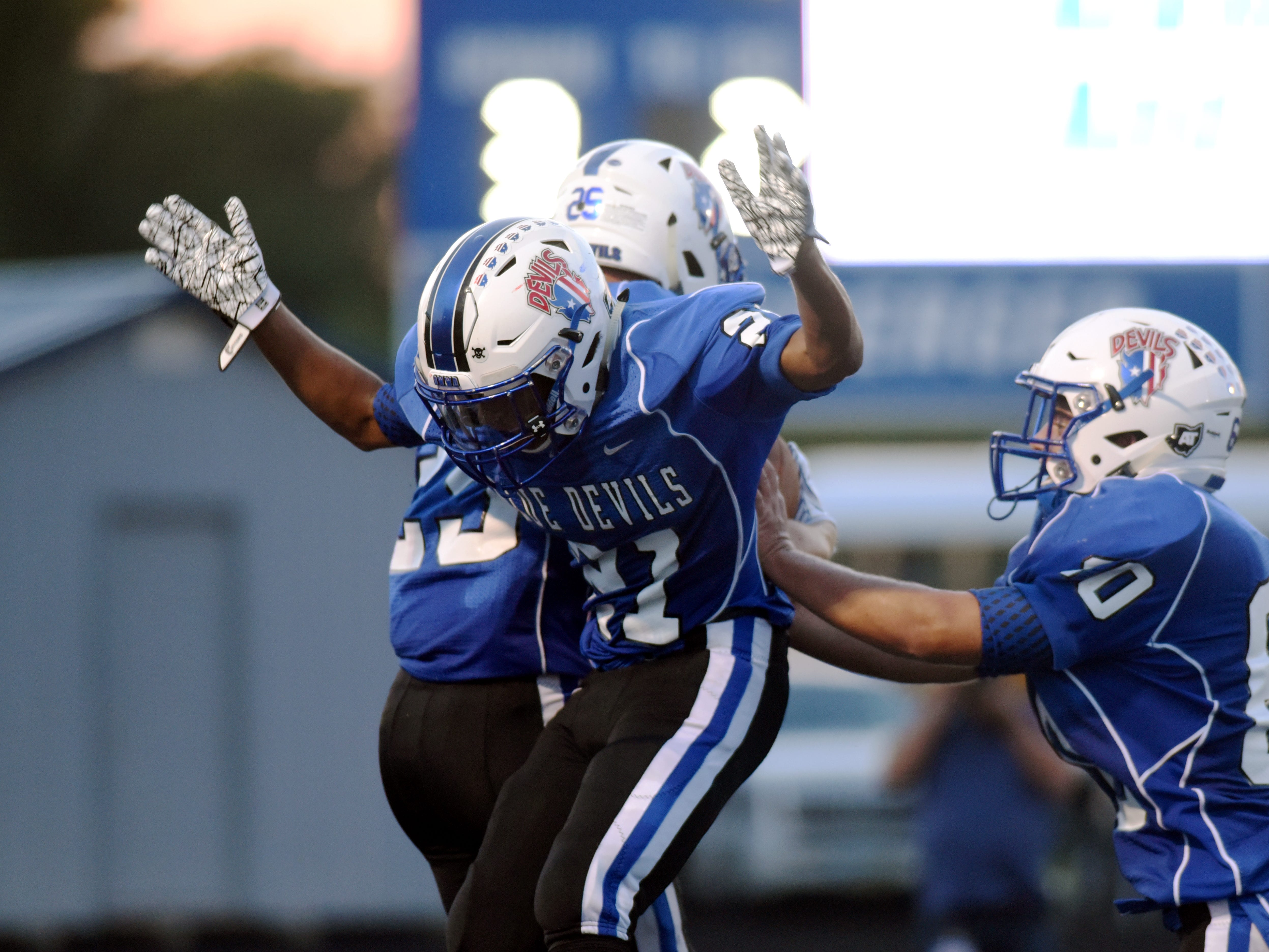 Dekker Davis and Julius Murphy, of Zanesville, celebrate in the end zone after Davis caught a 7-yard touchdown pass in the second quarter against Granville.