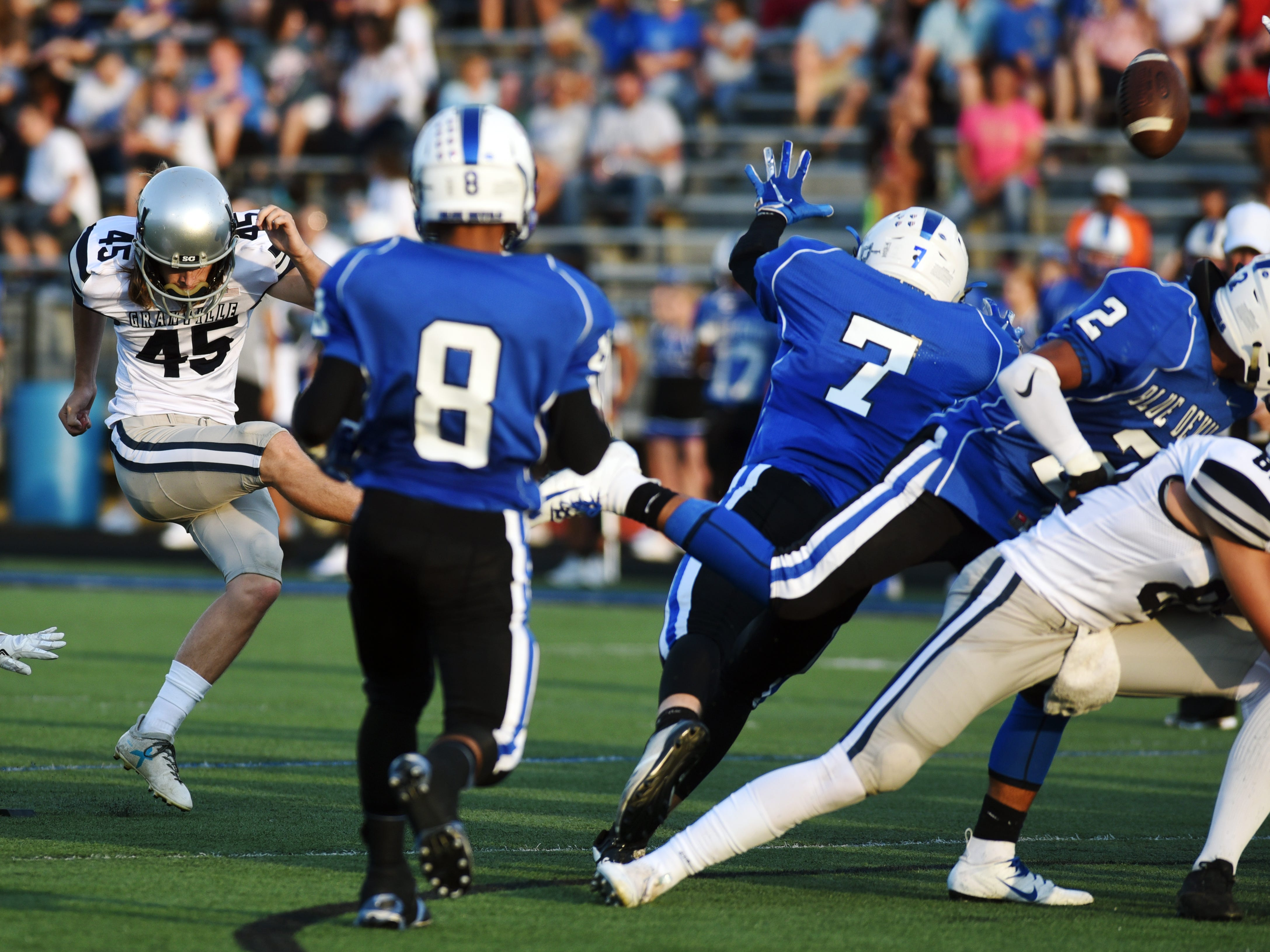 Craig Zies, of Granville, kicks a field goal in the first quarter. The Blue Aces held on for a 17-14 win against Zanesville on Friday night at John D. Sulsberger Memorial Stadium.