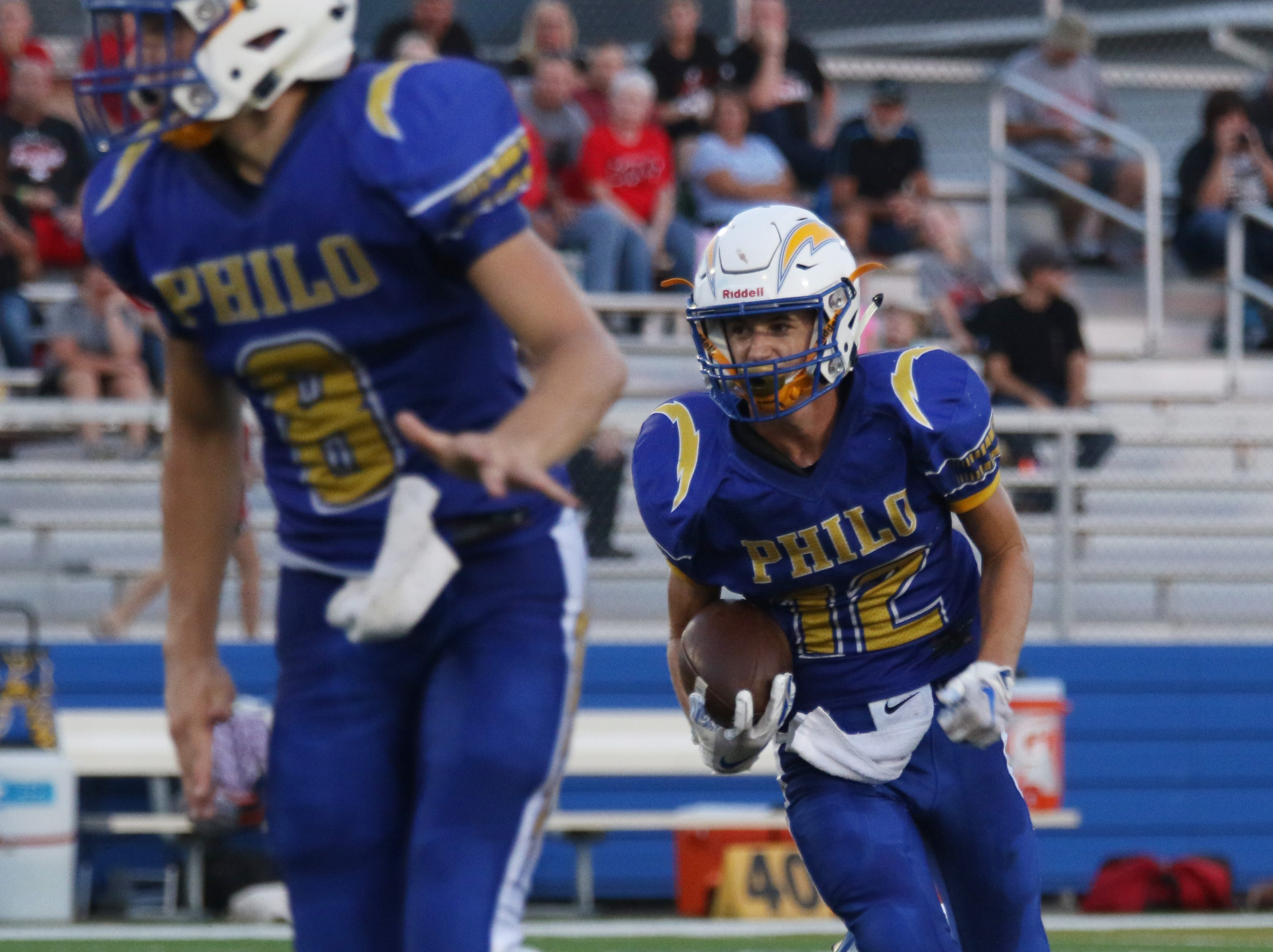 Philo's Aaronn Philip carries the ball against Crooksville.
