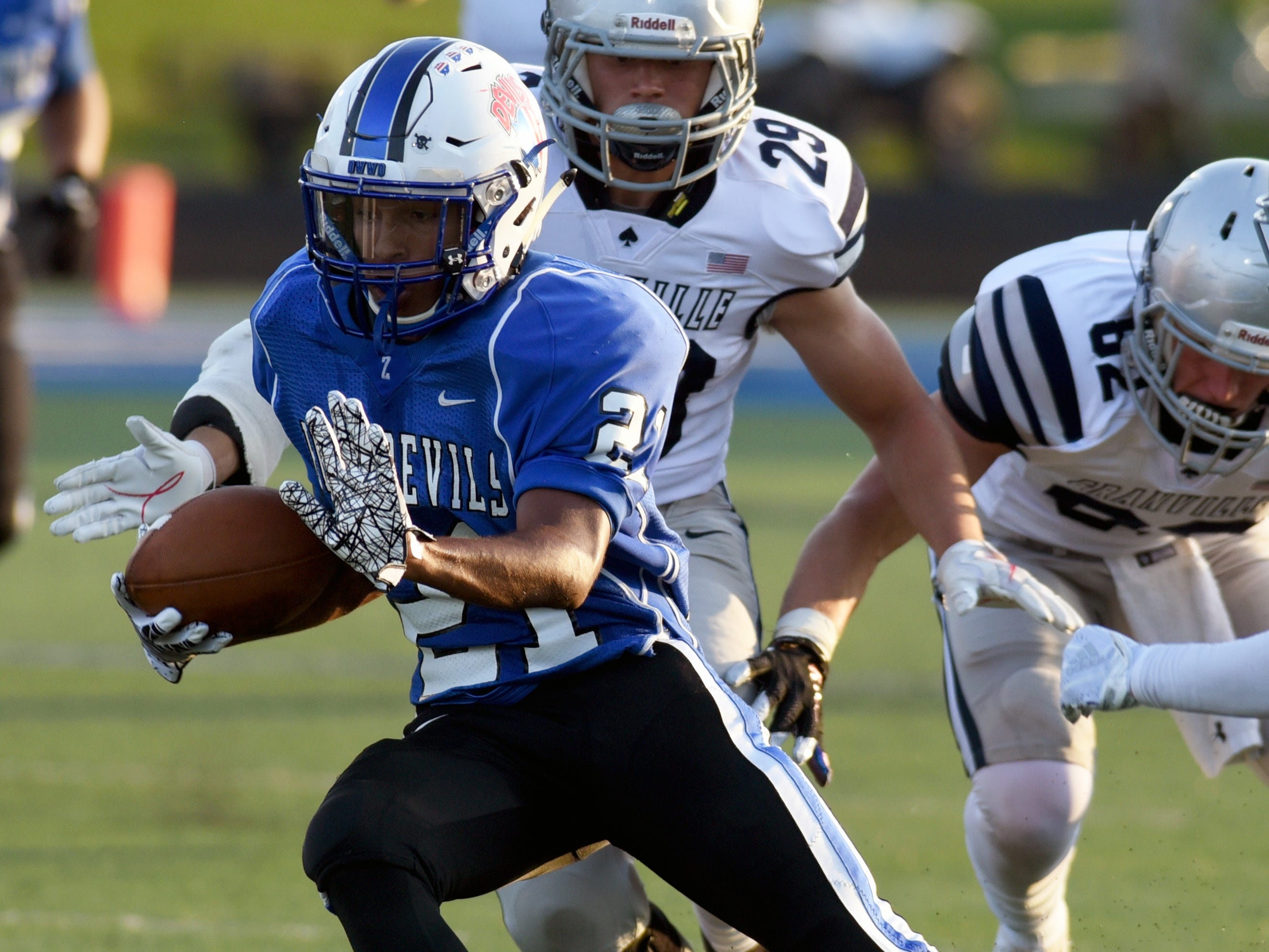 Zanesville's Julius Murphy runs with the ball after catching a pass against Granville. The Blue Aces held on for a 17-14 win on Friday night at John D. Sulsberger Memorial Stadium.