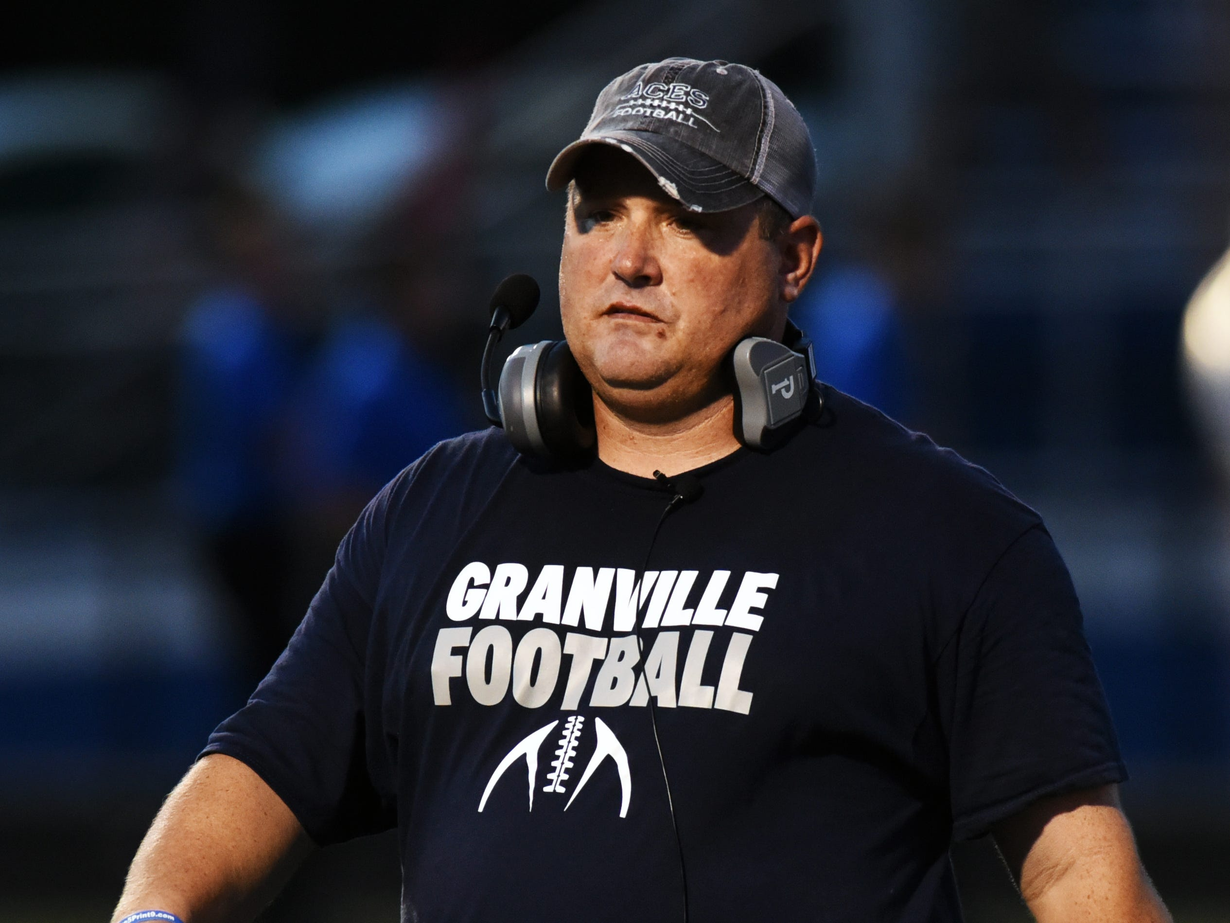 Granville coach Justin Buttermore walks off the field at halftime against Zanesville on Friday night at John D. Sulsberger Memorial Stadium. The Blue Aces won, 17-14.