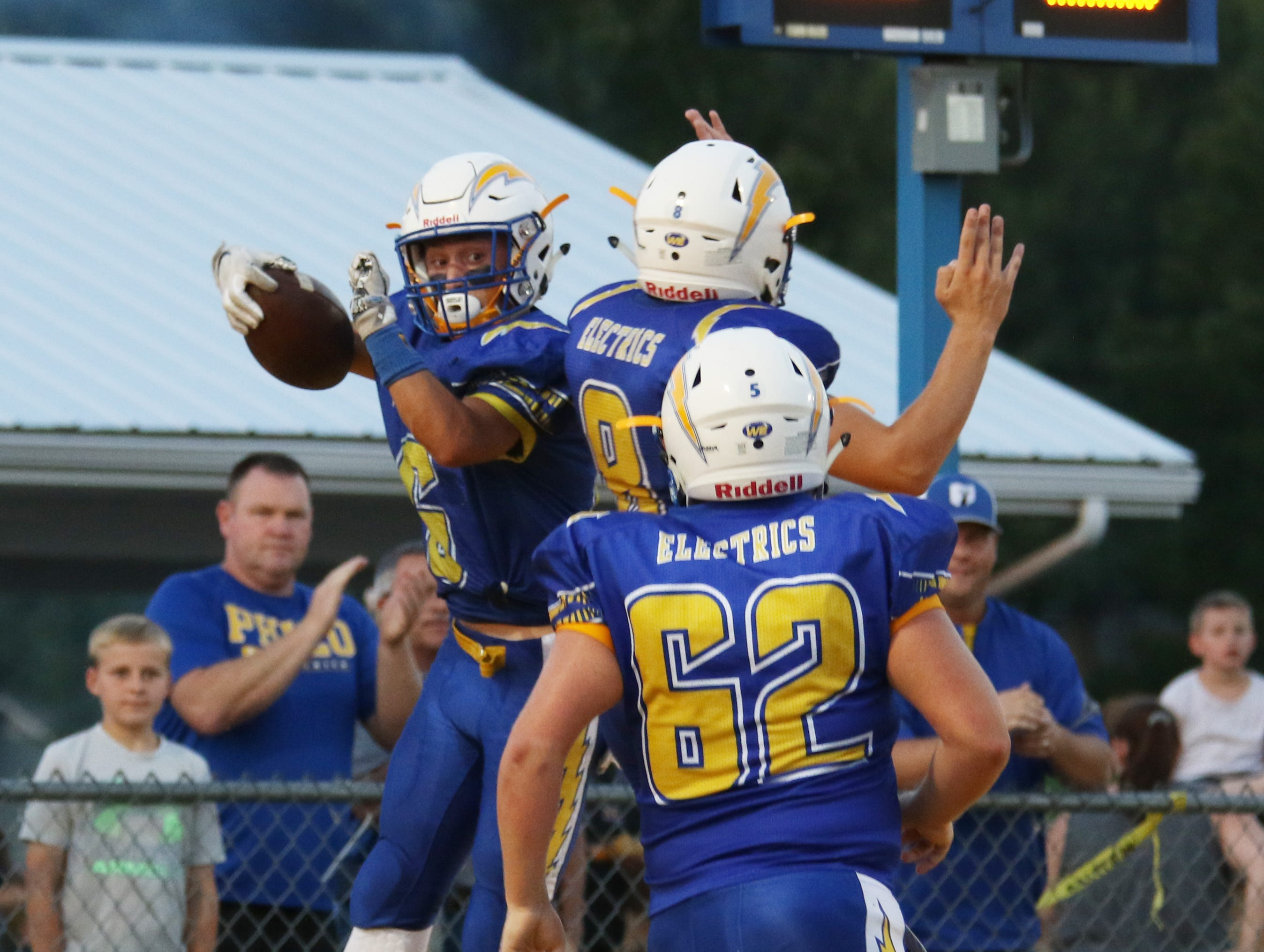 Philo celebrates Casey Munyan's touchdown against Crooksville.