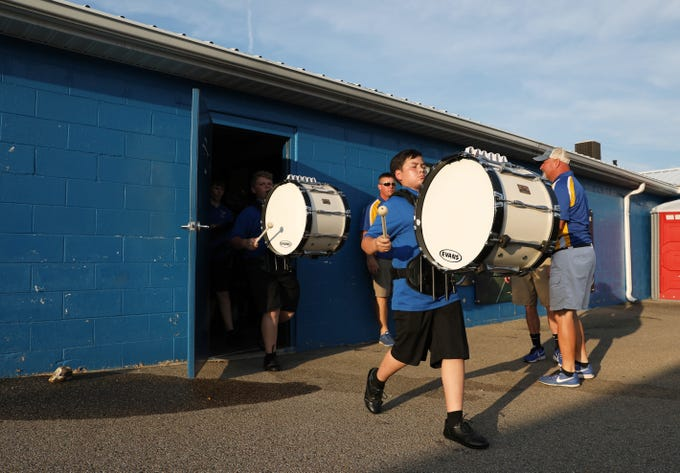 Percussion from the Philo High School marching band leads the Electrics out of the locker room before taking on Crooksville.