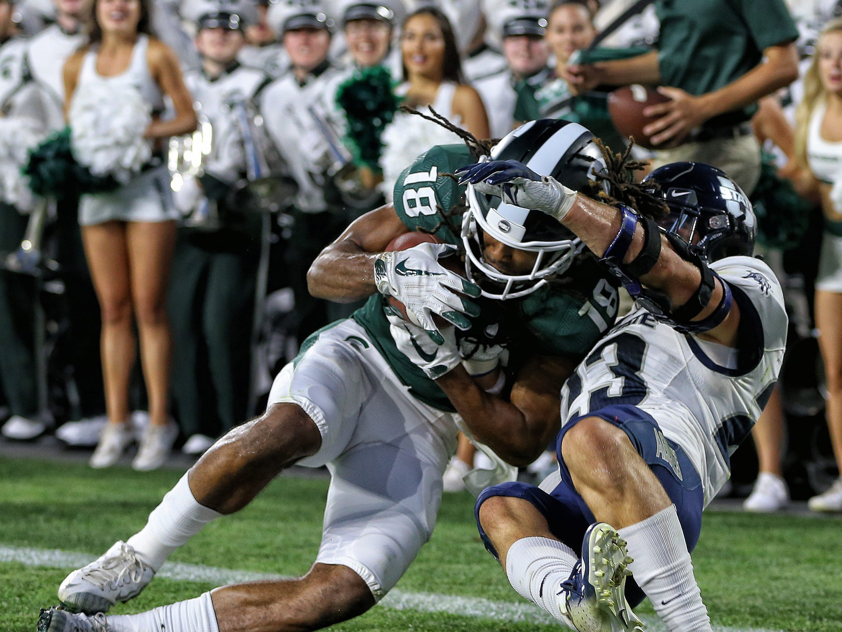 Michigan State Spartans wide receiver Felton Davis III (18) cathes a touchdown against Utah State Aggies safety Gaje Ferguson (23) during the first half.
