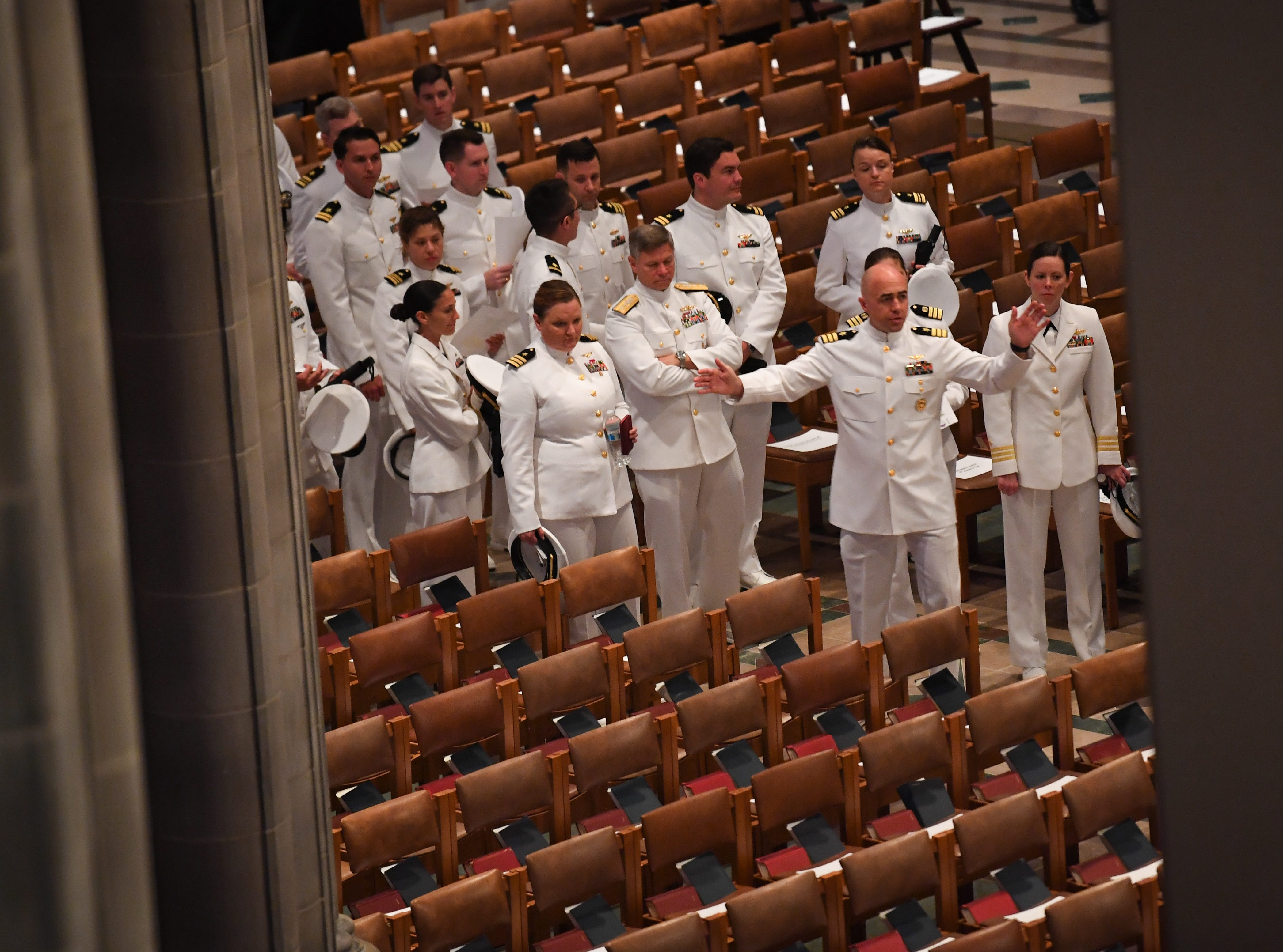 Naval officers prepare for the memorial service for John McCain at the National Cathedral.