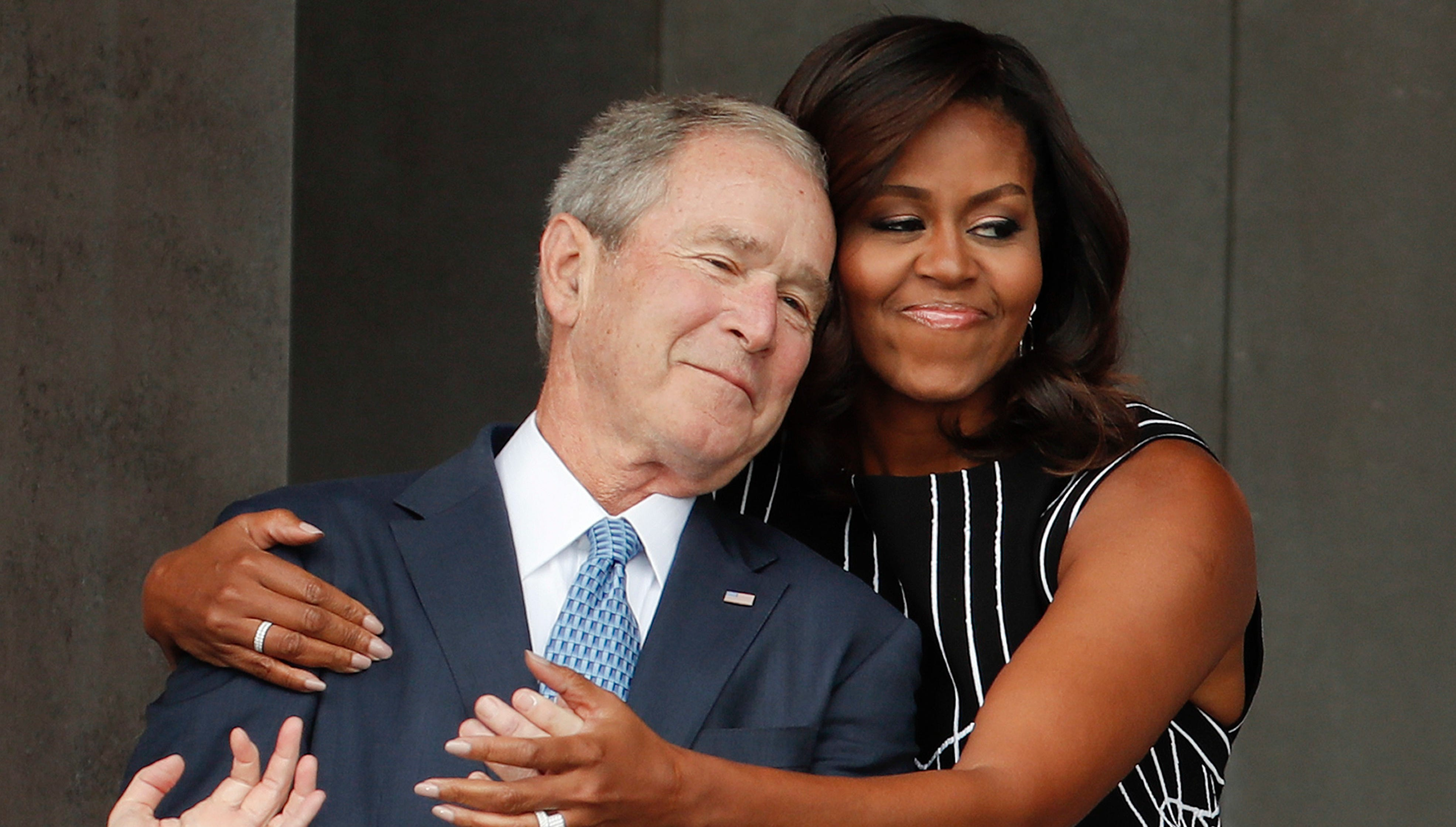 Michelle Obama: George W. Bush is 'my partner in crime' and 'I love him to death'