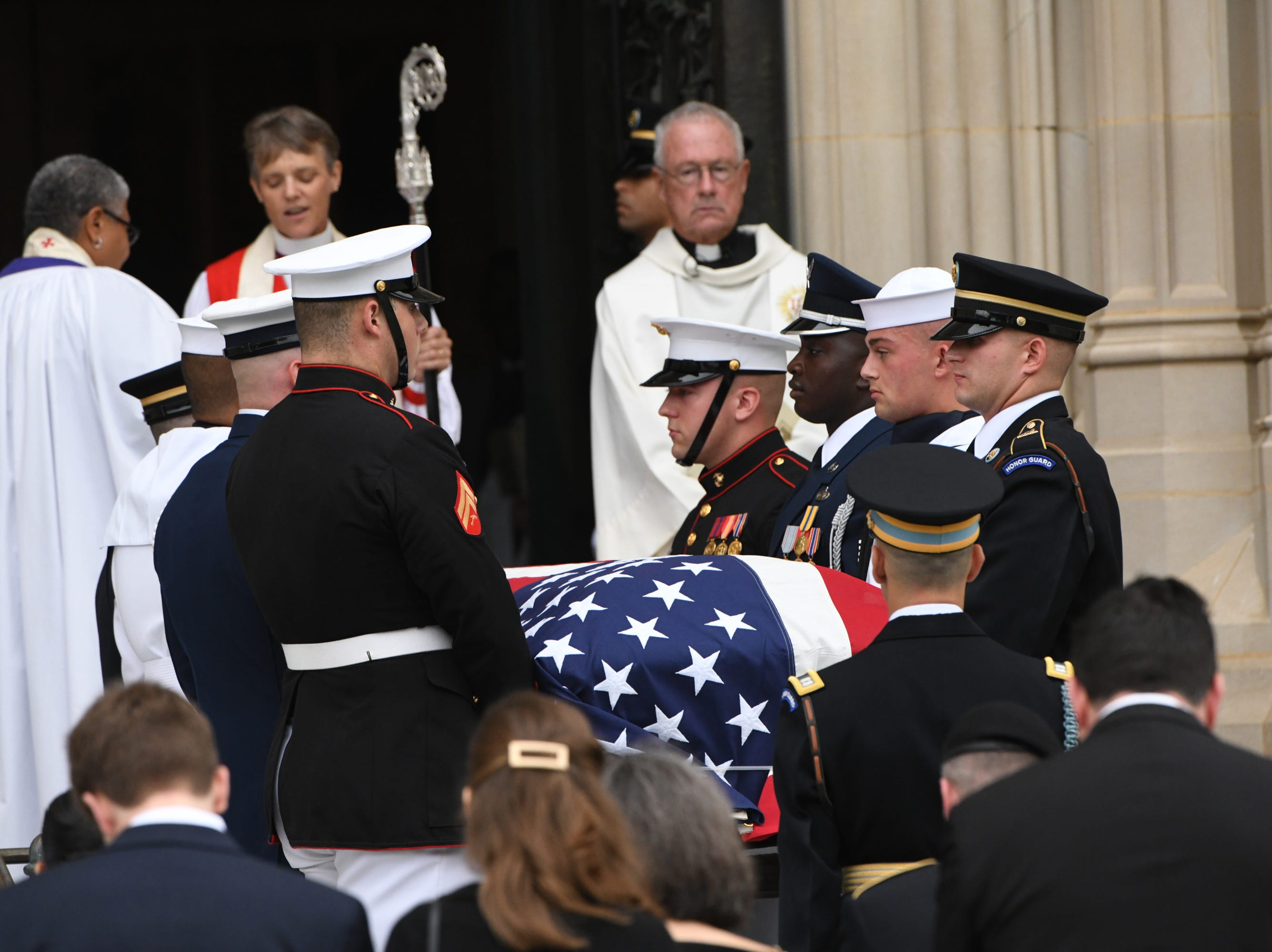 The casket of John McCain is carried into the National Cathedral in Washington for his memorial service on Sept. 1, 2018.  Sen. McCain died on Aug. 25.