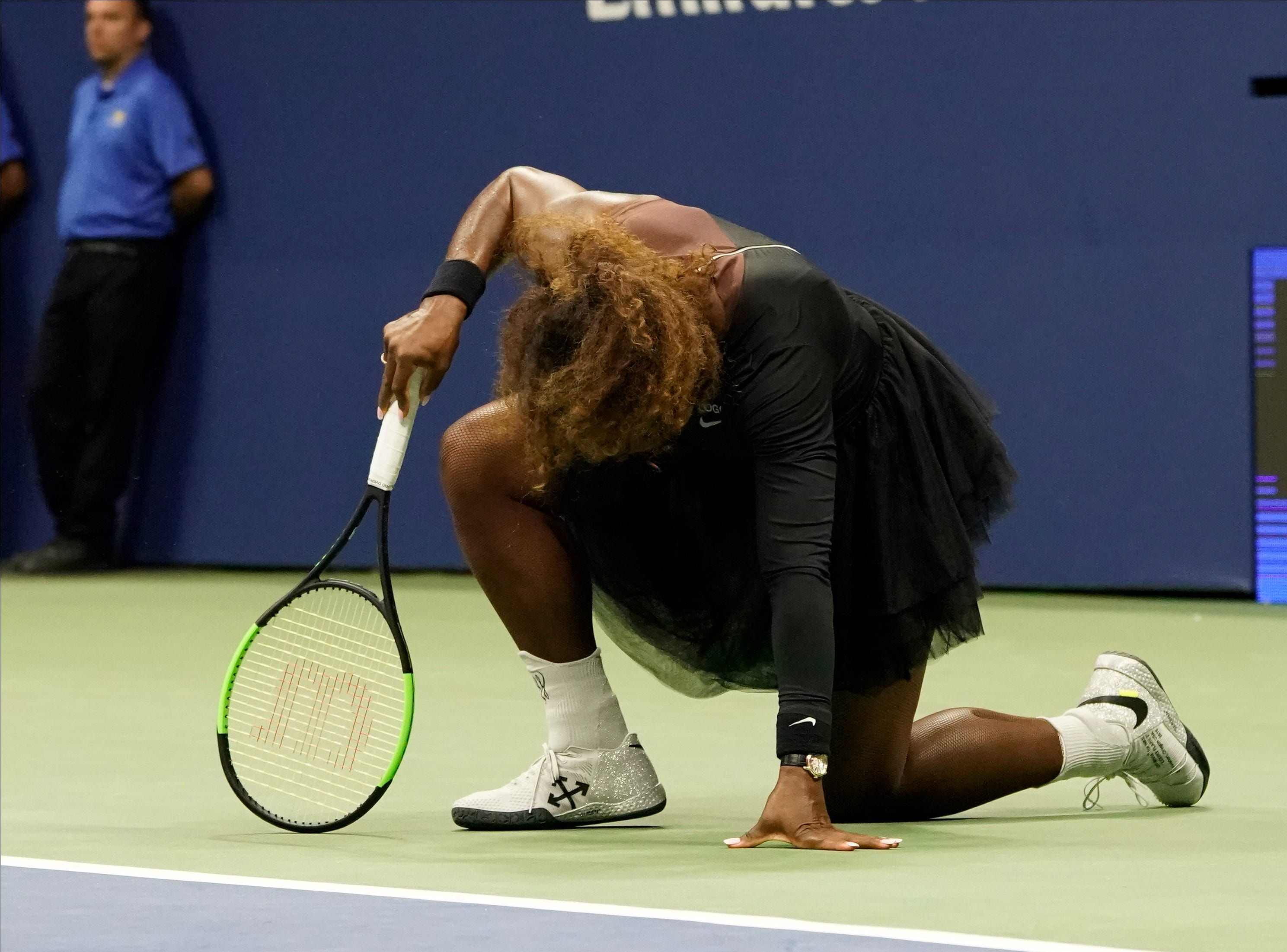 Serena Williams falls after twisting her ankle.