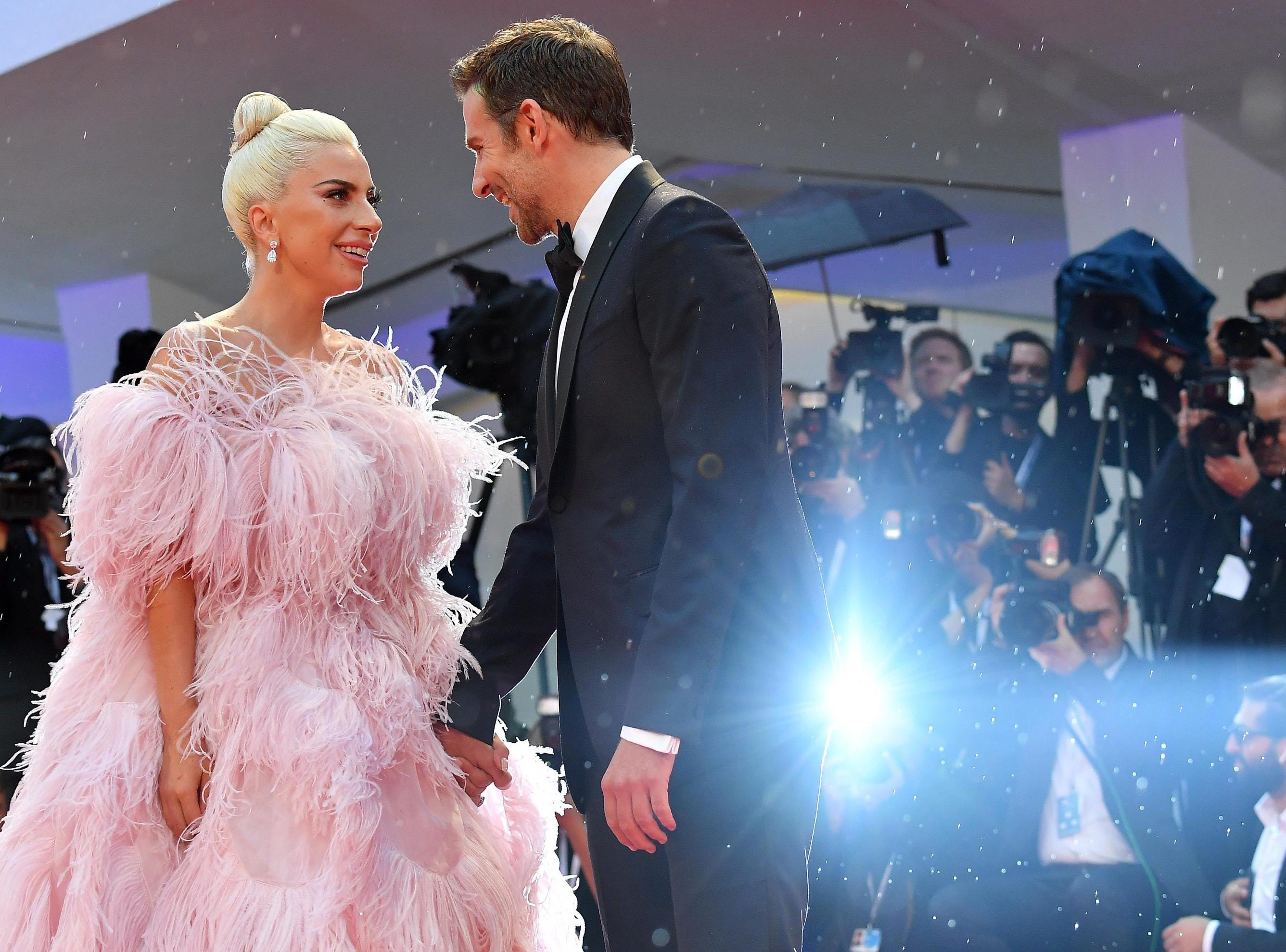 """She also walked hand-in-hand with """"A Star Is Born"""" co-star Bradley Cooper."""