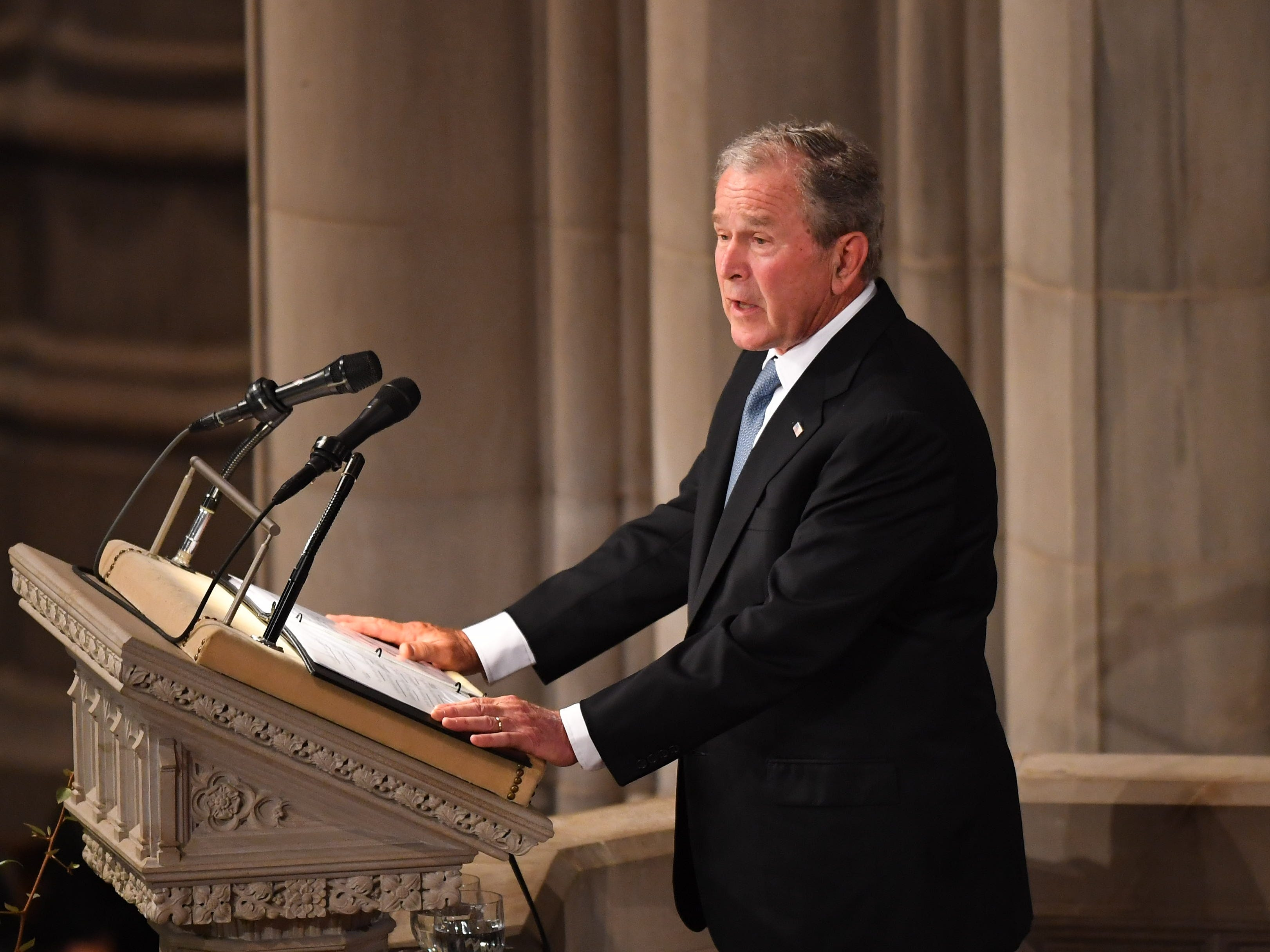 Former President George W. Bush at the remembers  John McCain at the National Cathedral on Saturday.