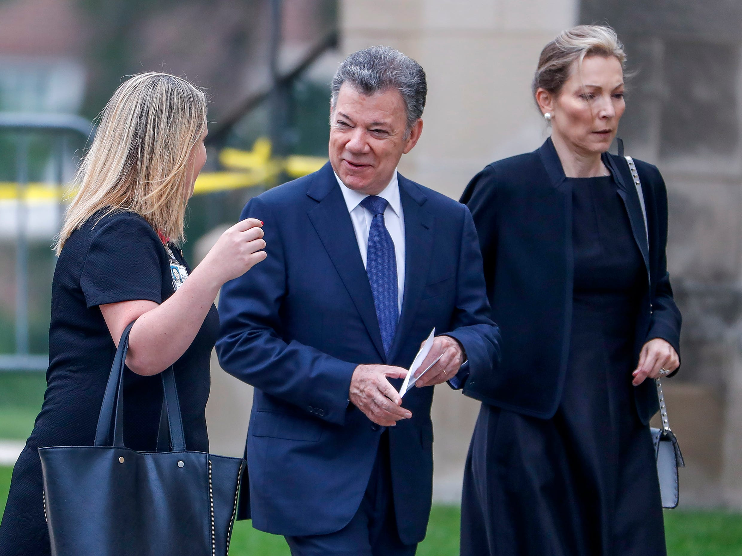 Former president of Colombia Juan Manuel Santos (C) and his wife Maria Clemencia Rodriguez Munera (R) arrive for the memorial service for Senator John McCain at the Washington National Cathedral. McCain died from brain cancer at his ranch in Sedona, Ariz. He was a veteran of the Vietnam War, served two terms in the  House of Representatives, and was elected to five terms in the Senate. McCain also ran for president twice, and was the Republican nominee in 2008.