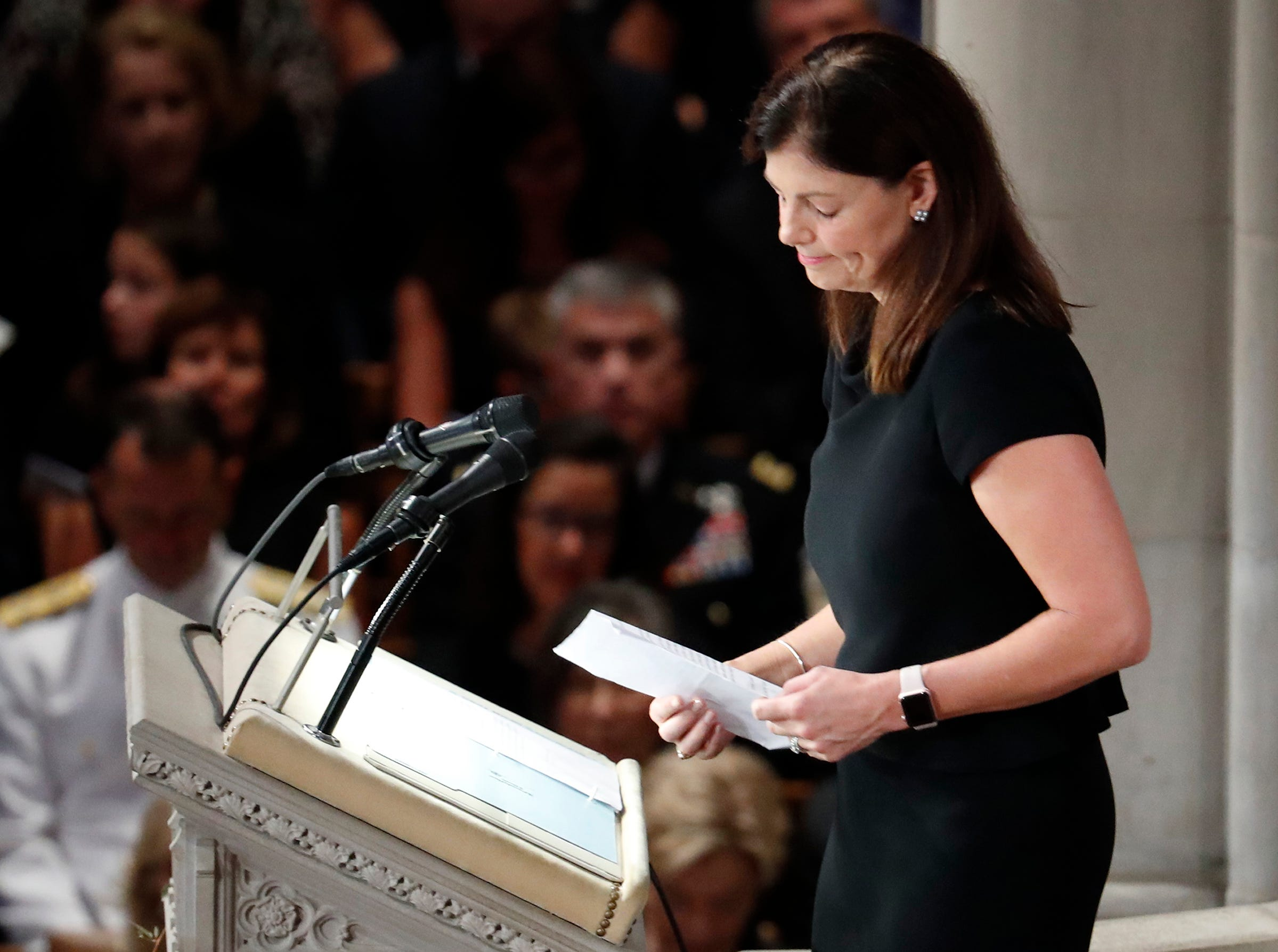 Former New Hampshire Sen. Kelly Ayotte reads scripture at a memorial service for Sen. John McCain, R-Ariz.