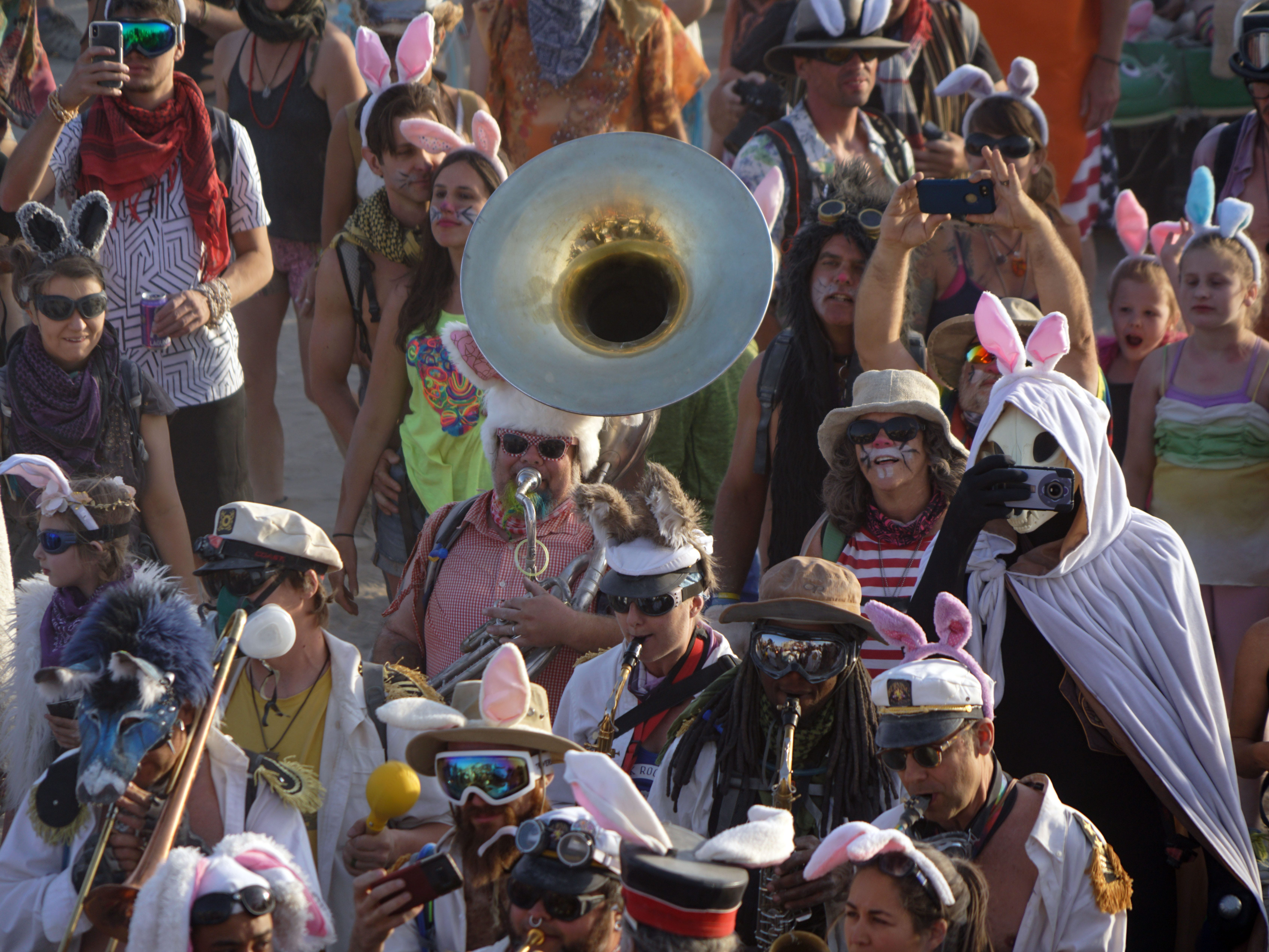 "Derek ""Doc Sousa"" Wingfield plays a sousaphone during a parade of hundreds of people dressed up at rabbits during Burning Man Aug 31, 2018."