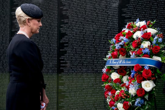 Cindy McCain, wife of, Sen. John McCain, R-Ariz., lays a wreath at the Vietnam Veterans Memorial in Washington, during a funeral procession to carry the casket of her husband from the US Capitol to National Cathedral for a Memorial Service.