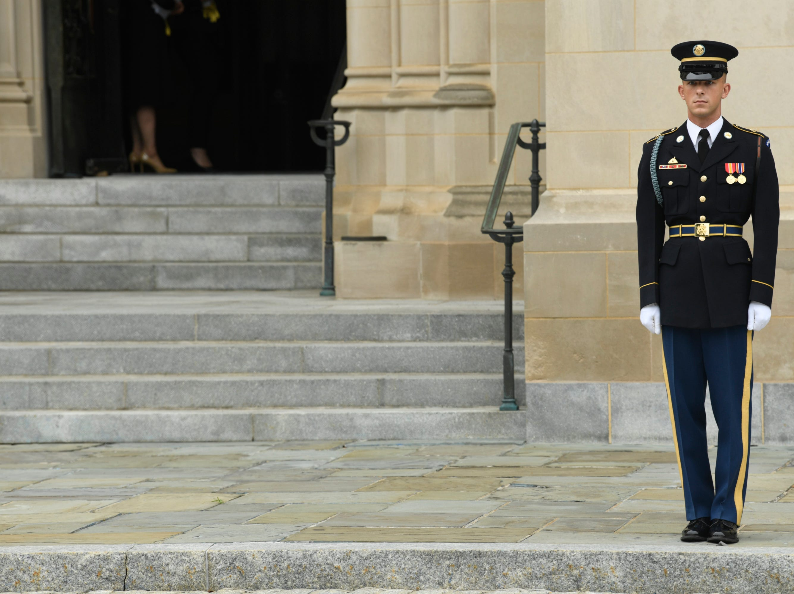 A member of the military honor guard team awaits the arrival of John McCain's casket at the National Cathedral.