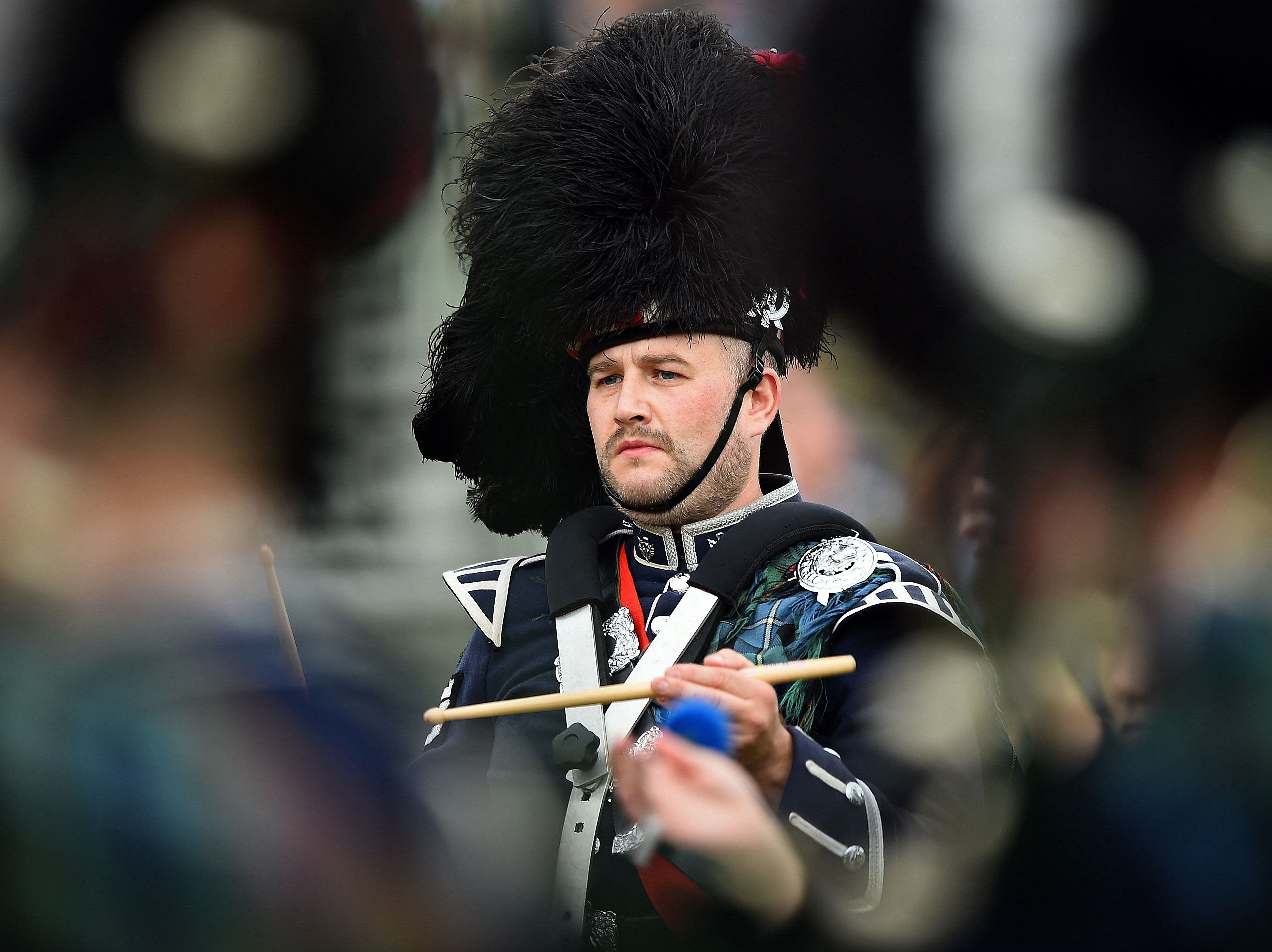 A drummer performs during the Massed Pipe Band parade at the annual Braemar Gathering.