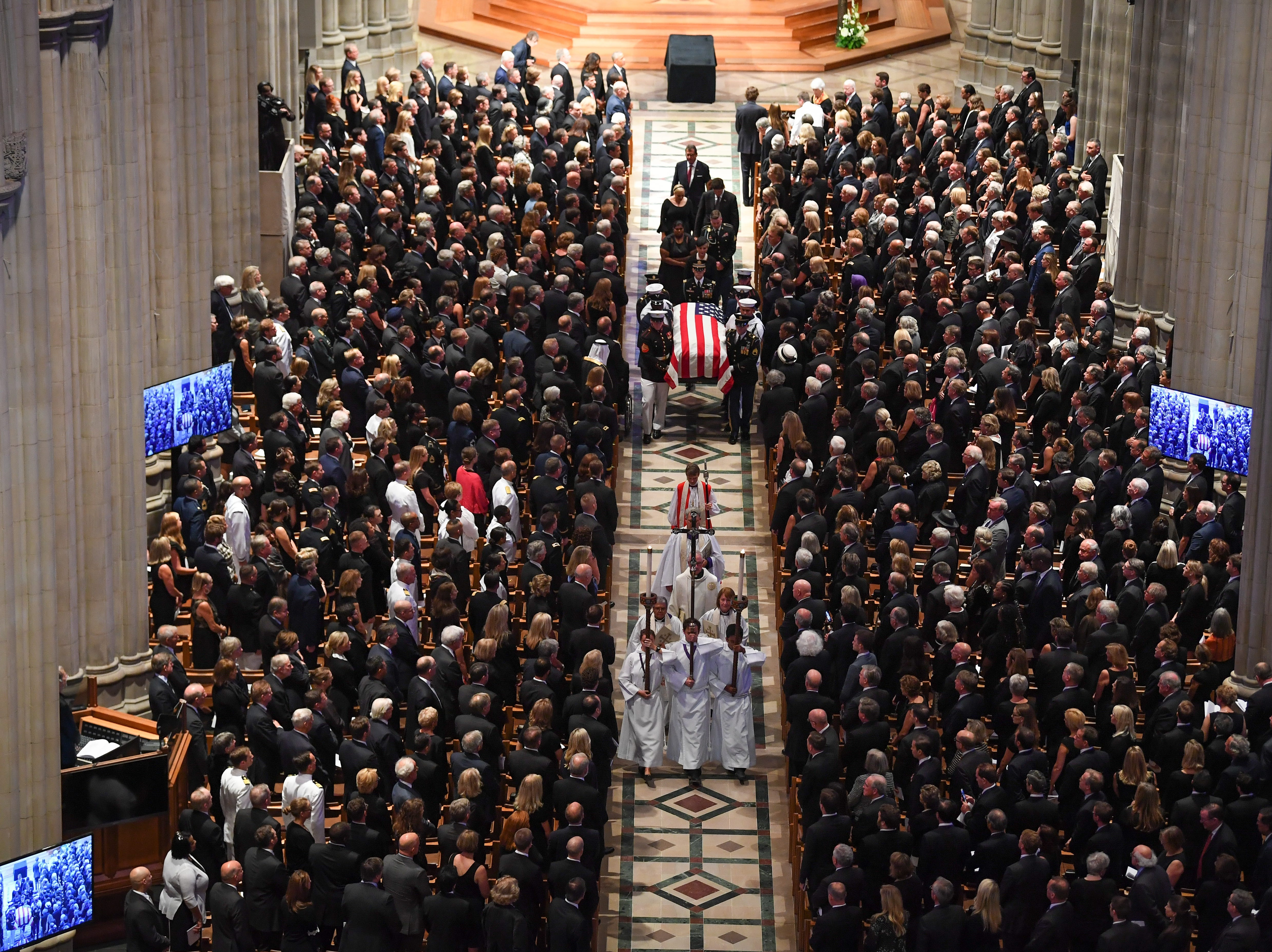 John McCain's widow Cindy and family members follow his casket at the conclusion of his memorial service at the National Cathedral in Washington, DC.