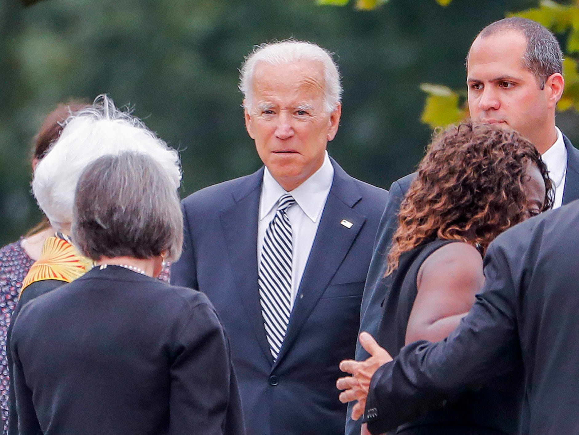 Former US Vice President Joe Biden (C) arrives for the memorial service for his good friend Senator John McCain at the Washington National Cathedral.