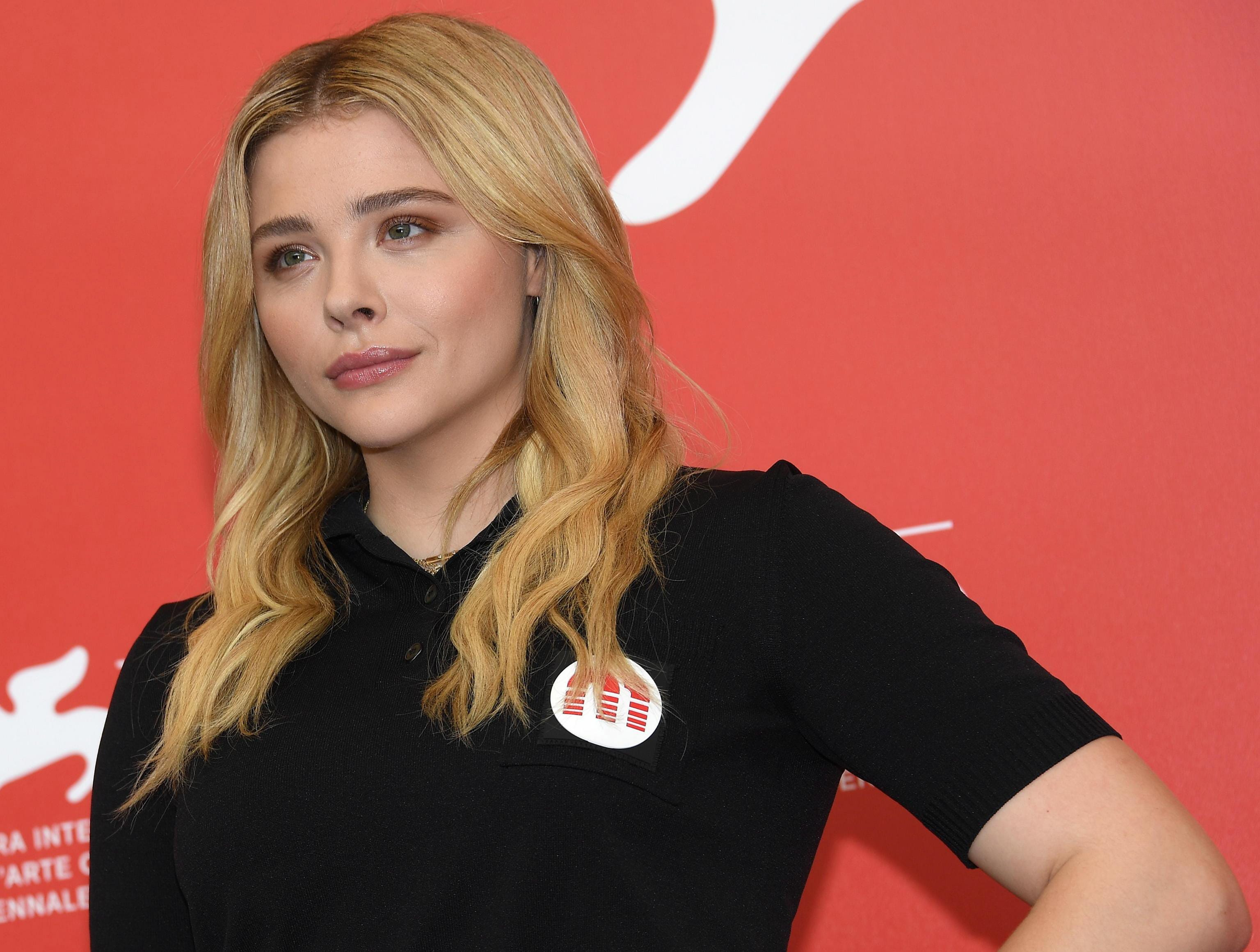 """Chloe Grace Moretz posed on the red carpet during a photocall for """"Suspiria."""""""