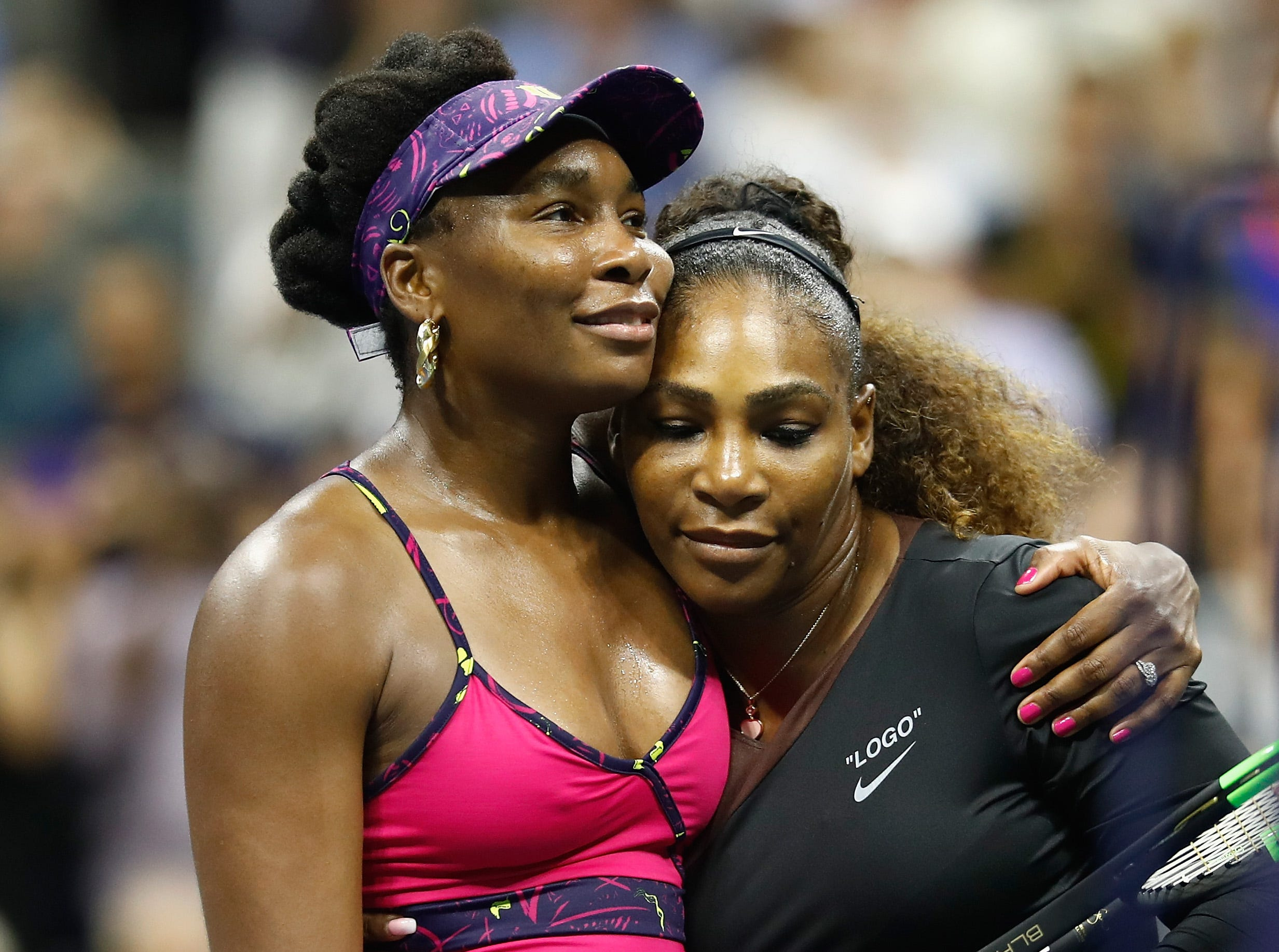 Venus Williams, left, hugs Serena after her sister's 6-1, 6-2 victory in the third round of the US Open.