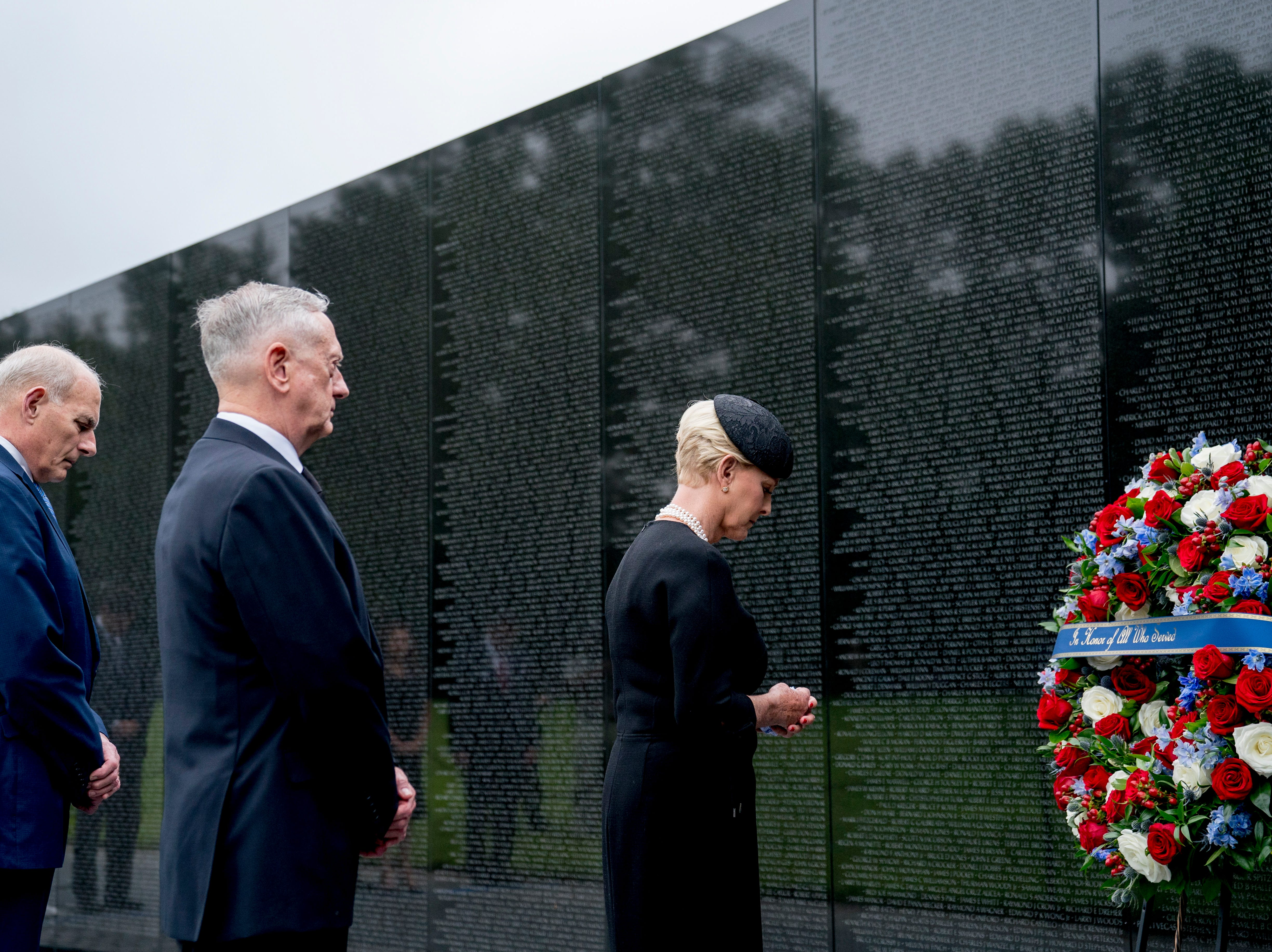 Cindy McCain, widow of, Sen. John McCain, R-Ariz., accompanied by President Donald Trump's Chief of Staff John Kelly (L) and Defense Secretary Jim Mattis (2-L) lays a wreath at the Vietnam Veterans Memorial in Washington, on Sept. 1, 2018, during a funeral procession to carry the casket of her husband from the US Capitol to National Cathedral for a Memorial Service. McCain died Aug. 25, 2018 from brain cancer at his ranch in Sedona, Ariz.