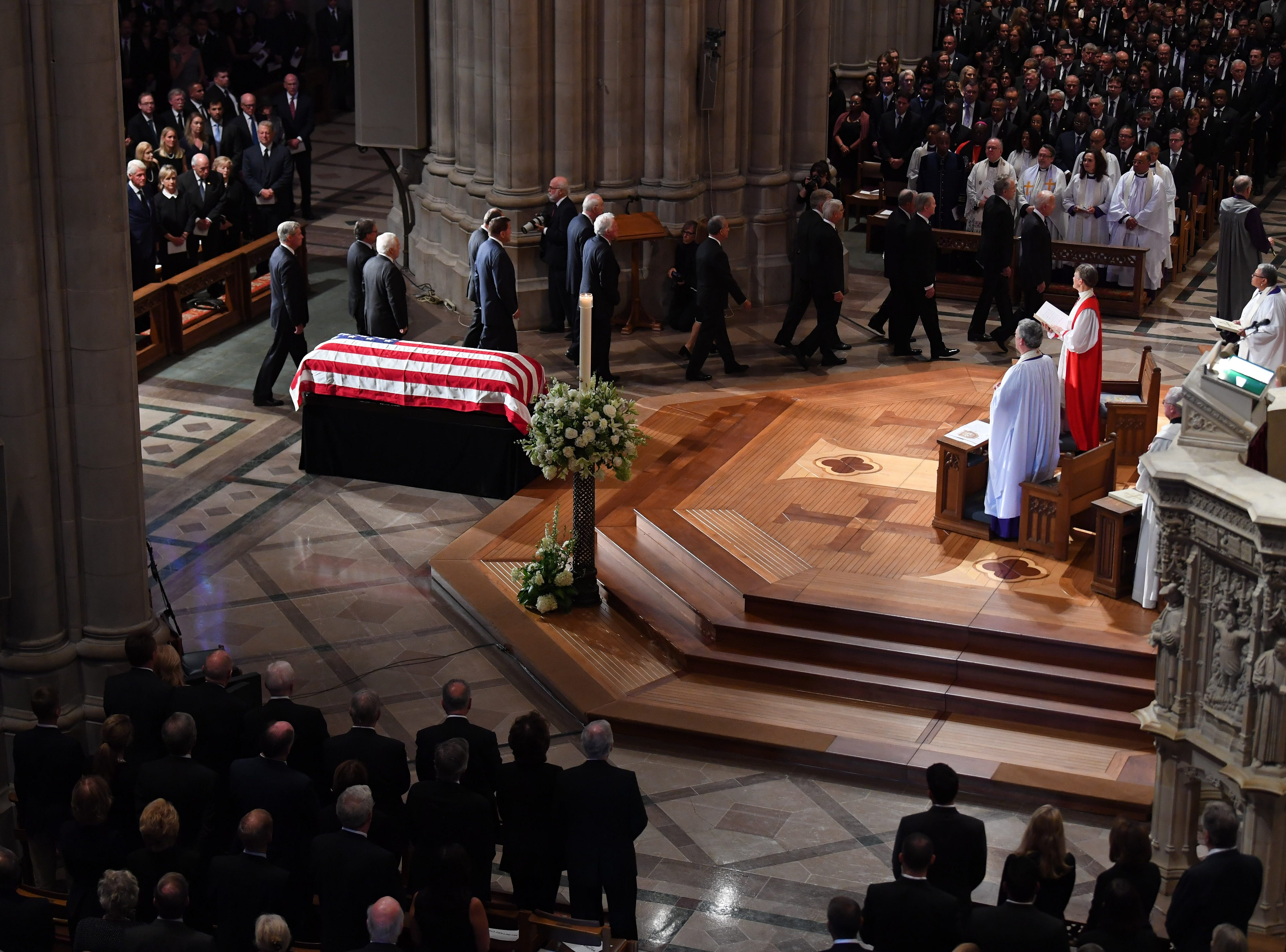 Mourners gather for the memorial service for John McCain at the National Cathedral in Washington, DC.