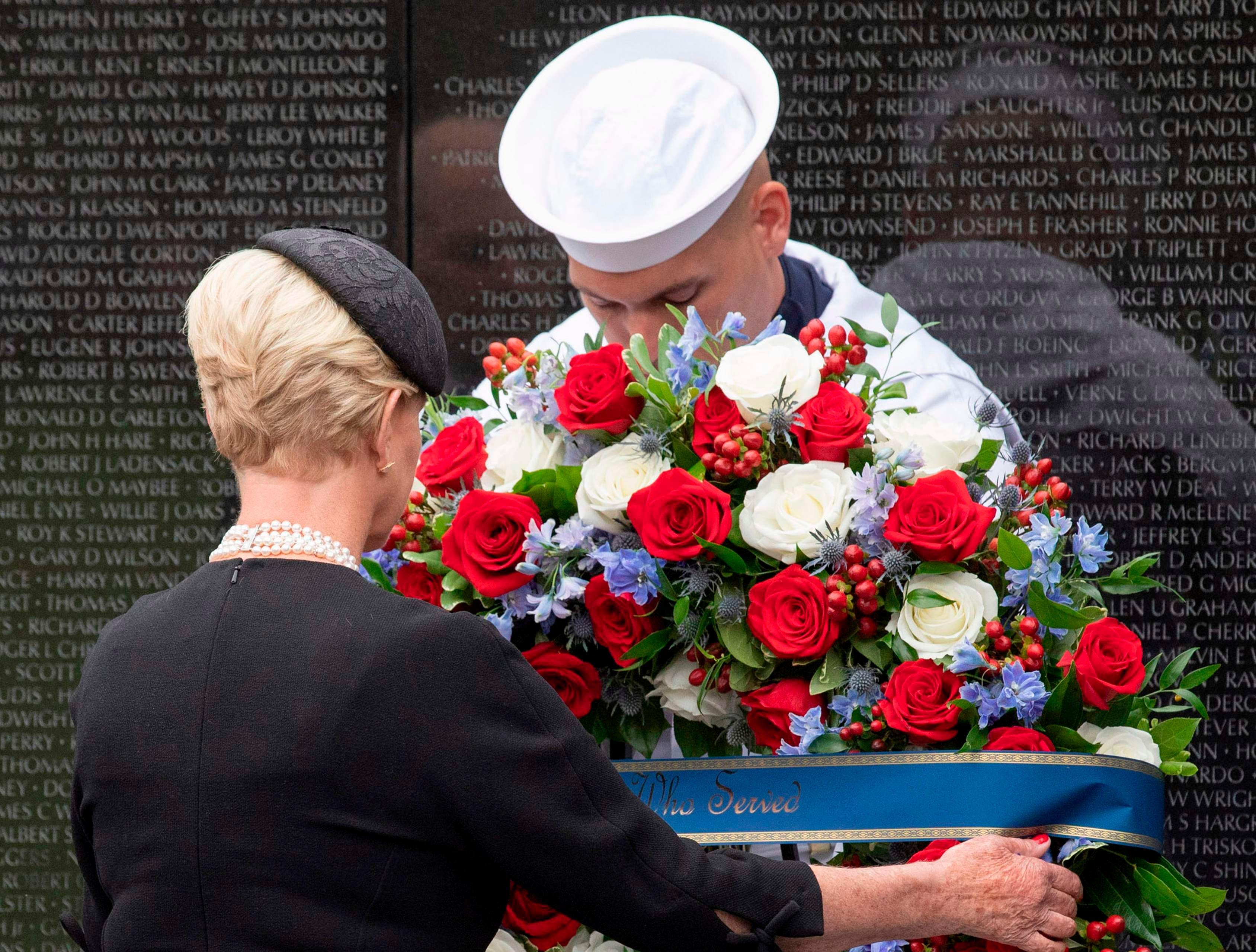 Cindy McCain , wife of US Senator John McCain, lays a wreath at the Vietnam Veterans Memorial, in Washington, DC.