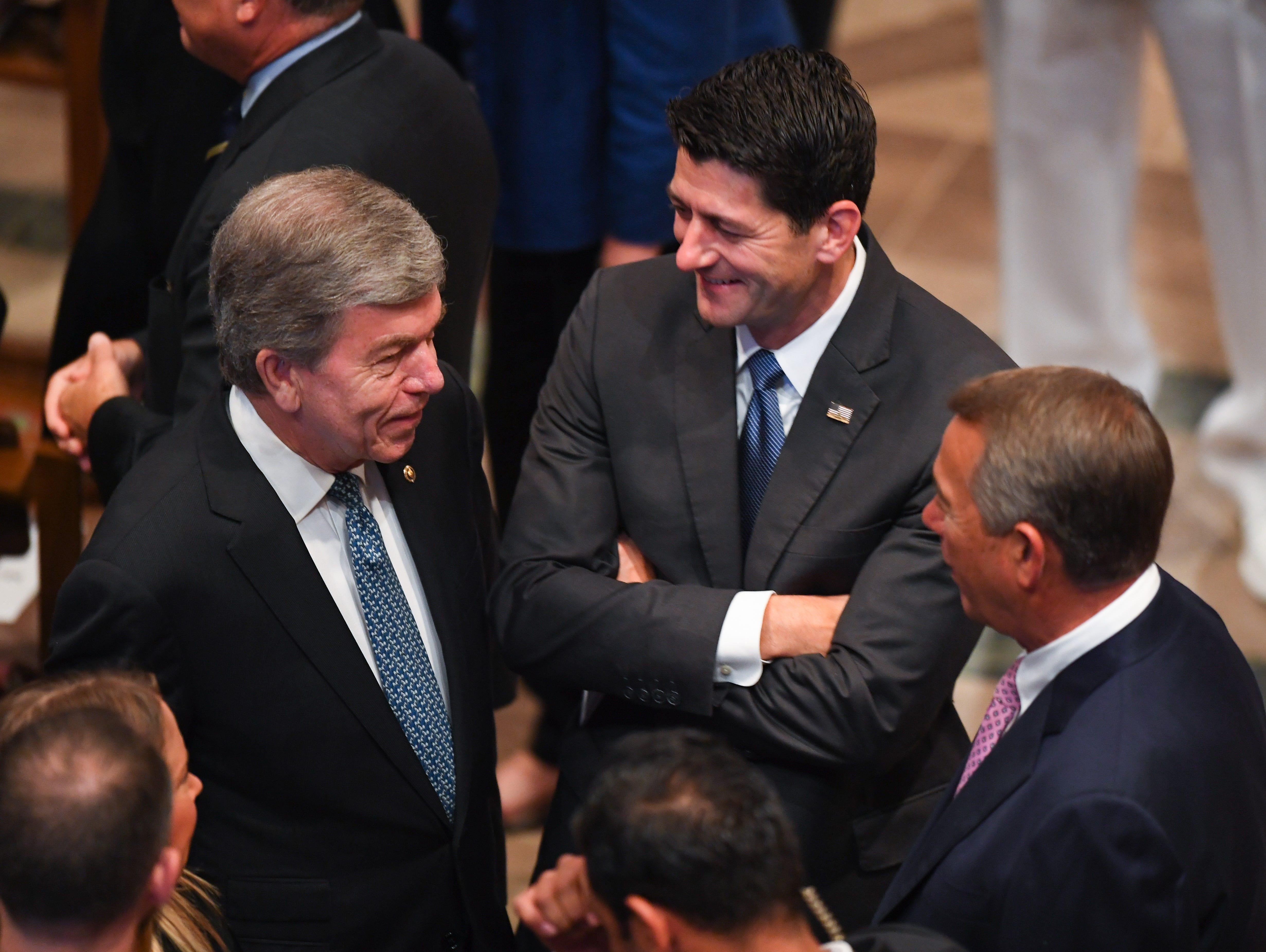 Senator Roy Blunt, left, speaks with House Speaker Paul Ryan and former House Speaker John Boehner as mourners gather for the memorial service for John McCain.