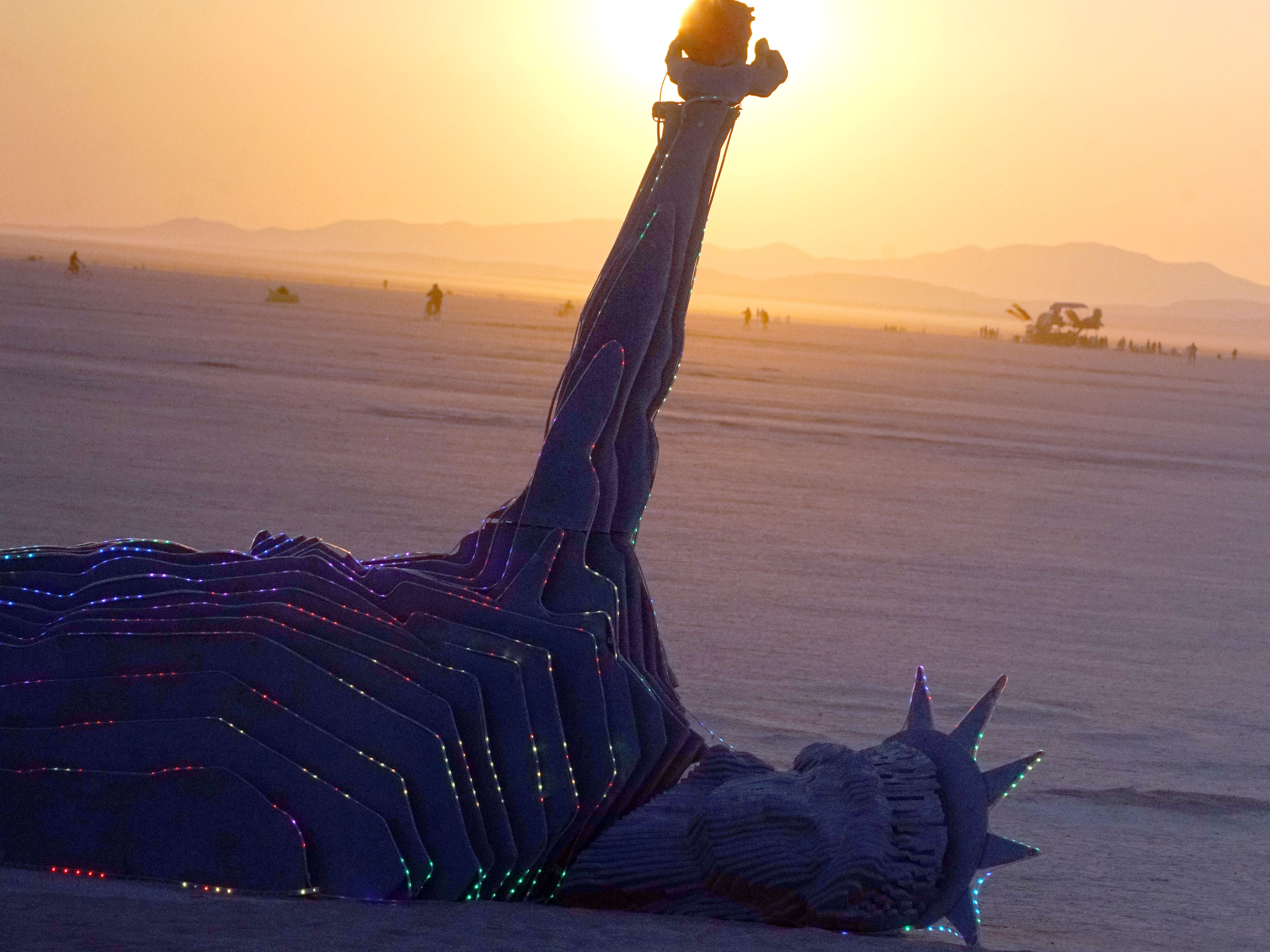 A piece of art at Burning Man depicts the Statue of Liberty laid down on the ground, her heart ripped out and held in her outstretched hand Sept. 1, 2018.