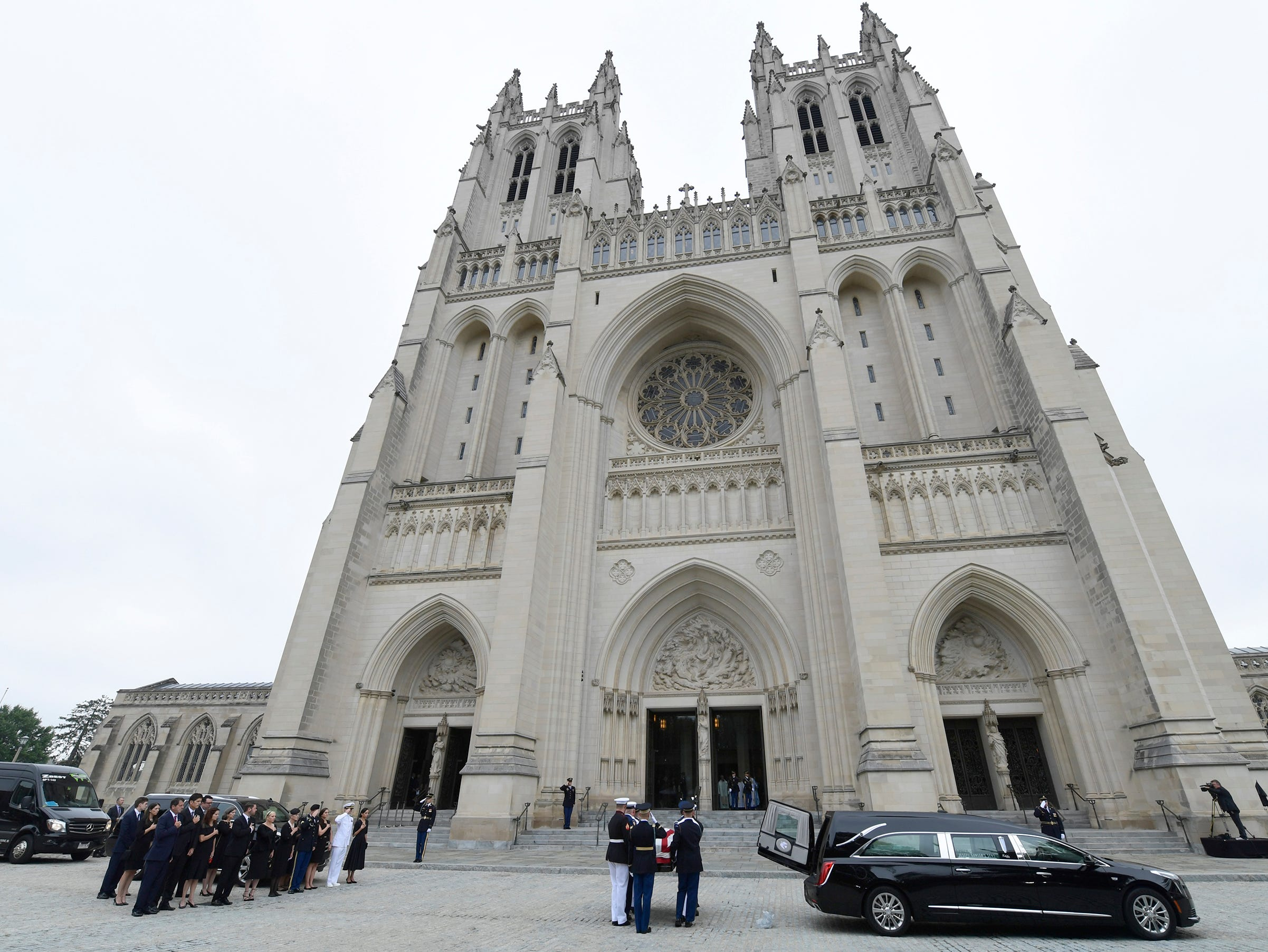 The casket of Sen. John McCain, R-Ariz., arrives for his memorial service at the Washington National Cathedral.