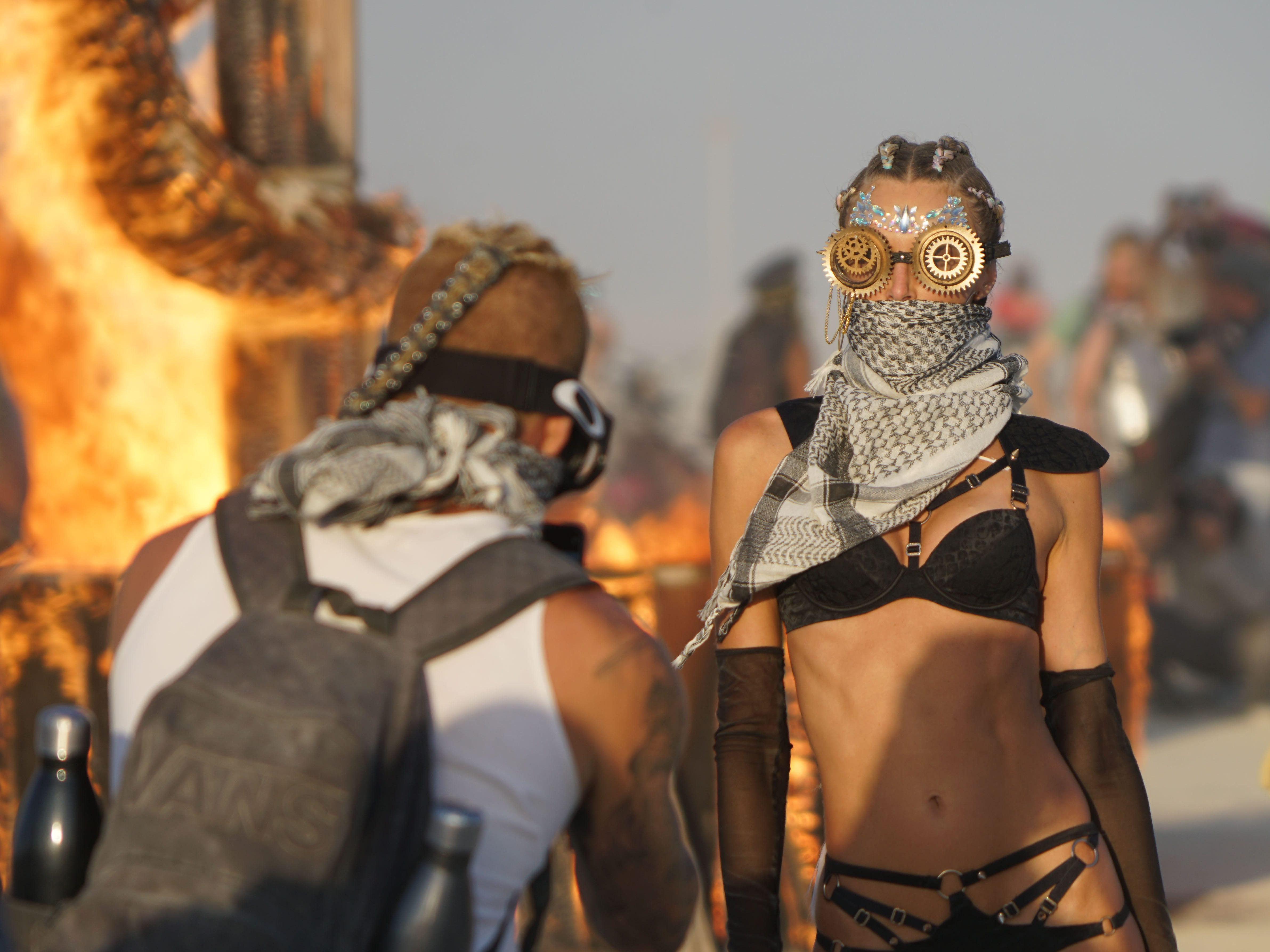 Los Angles-based model, designer and Instagram influencer Ludi Delfino poses for a photo taken by Eric Chambers in front of a burning sculpture at Burning Man Aug 31, 2018.