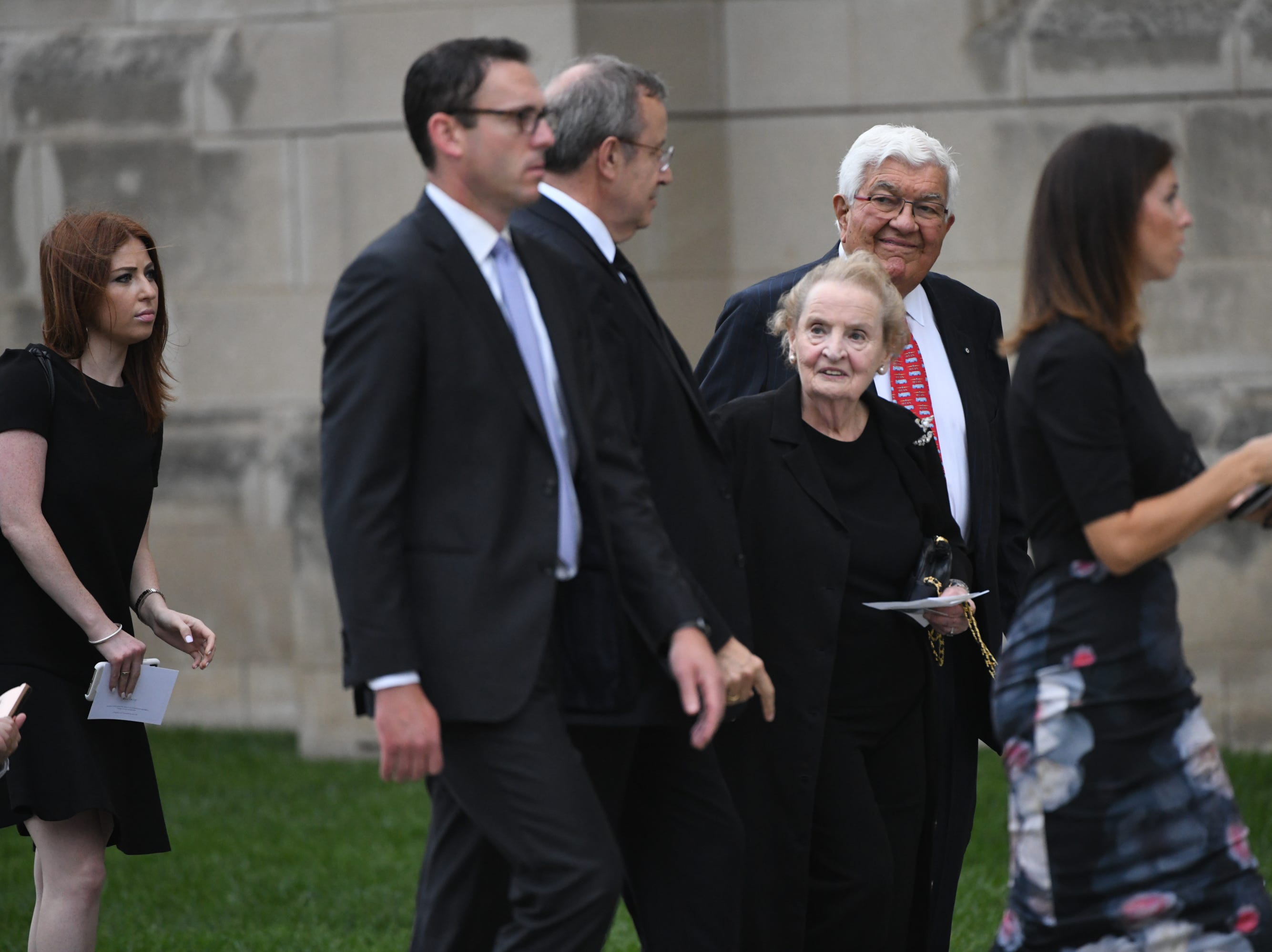 Former Secretary of State Madeleine Albright center approaches the National Cathedral, Saturday, in Washington, DC for a memorial service for John McCain.