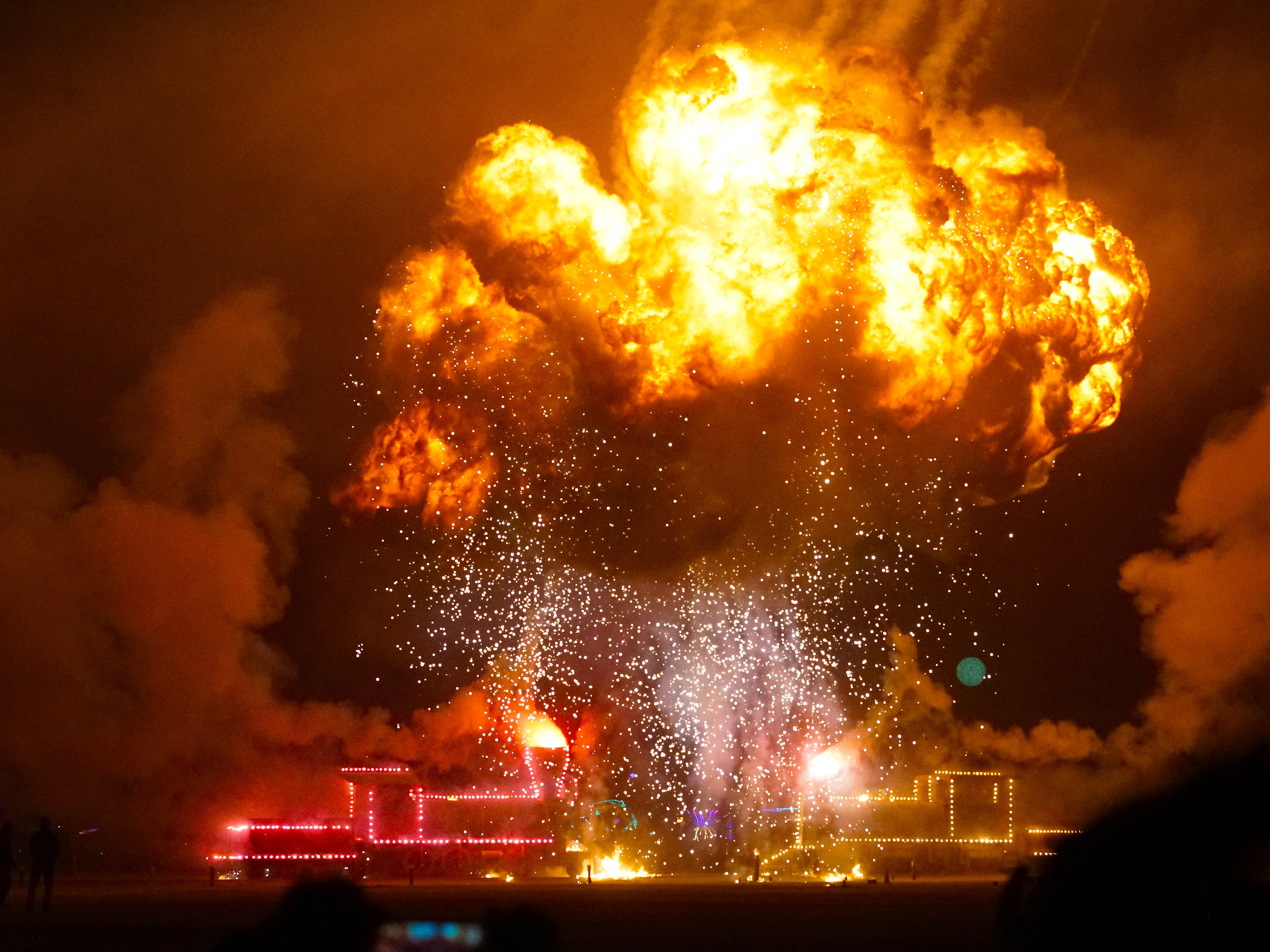 "A massive fireball roils into the night sky after an art installation of two (wooden) locomotives ""crashed"" into each other at Burning Man Sept. 1, 2018."