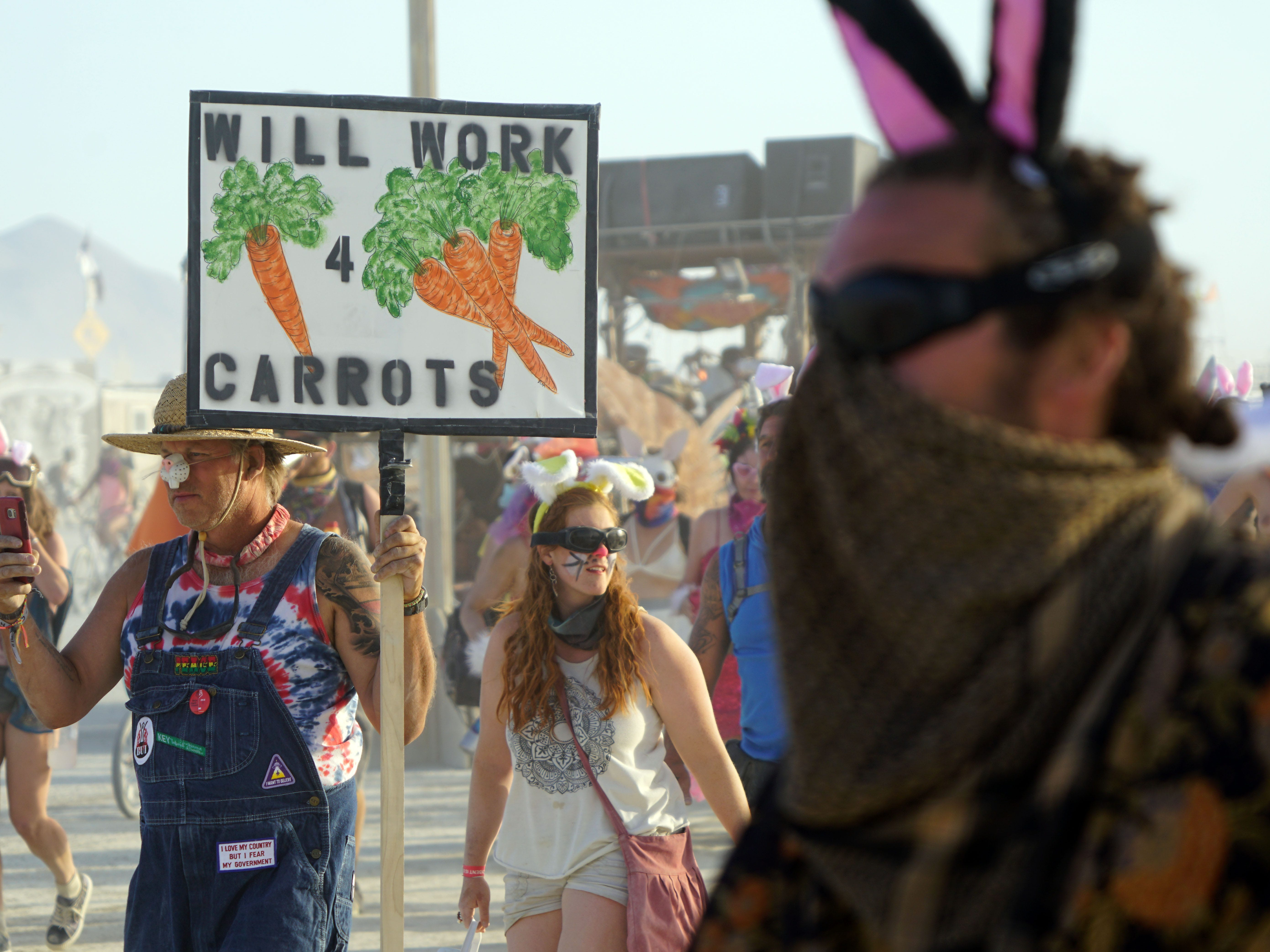 "Hundreds of Burning Man participants dressed up like bunnies march down the street as part of an annual ""chase"" between bunnies and carrots Aug 31, 2018."