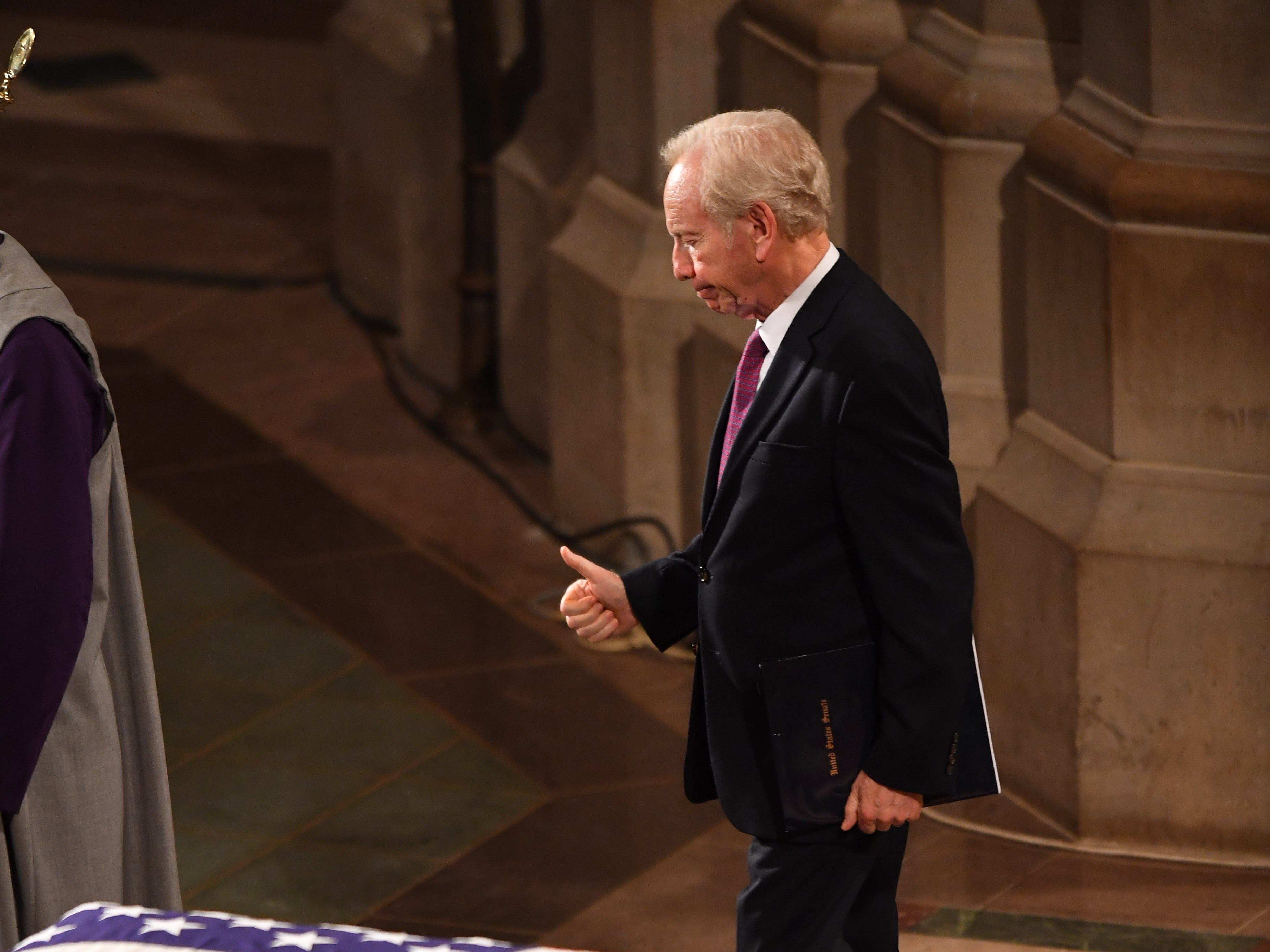 Joe Lieberman gives the 'thumbs up' at the memorial service for his friend John McCain at the National Cathedral.