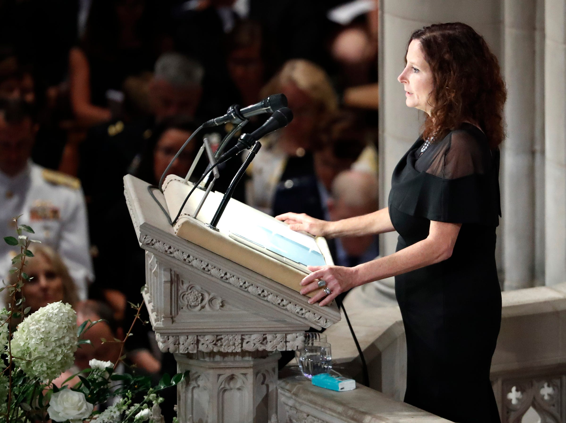 Sidney McCain reads scripture at a memorial service for her father, Sen. John McCain, R-Ariz., at Washington National Cathedral.