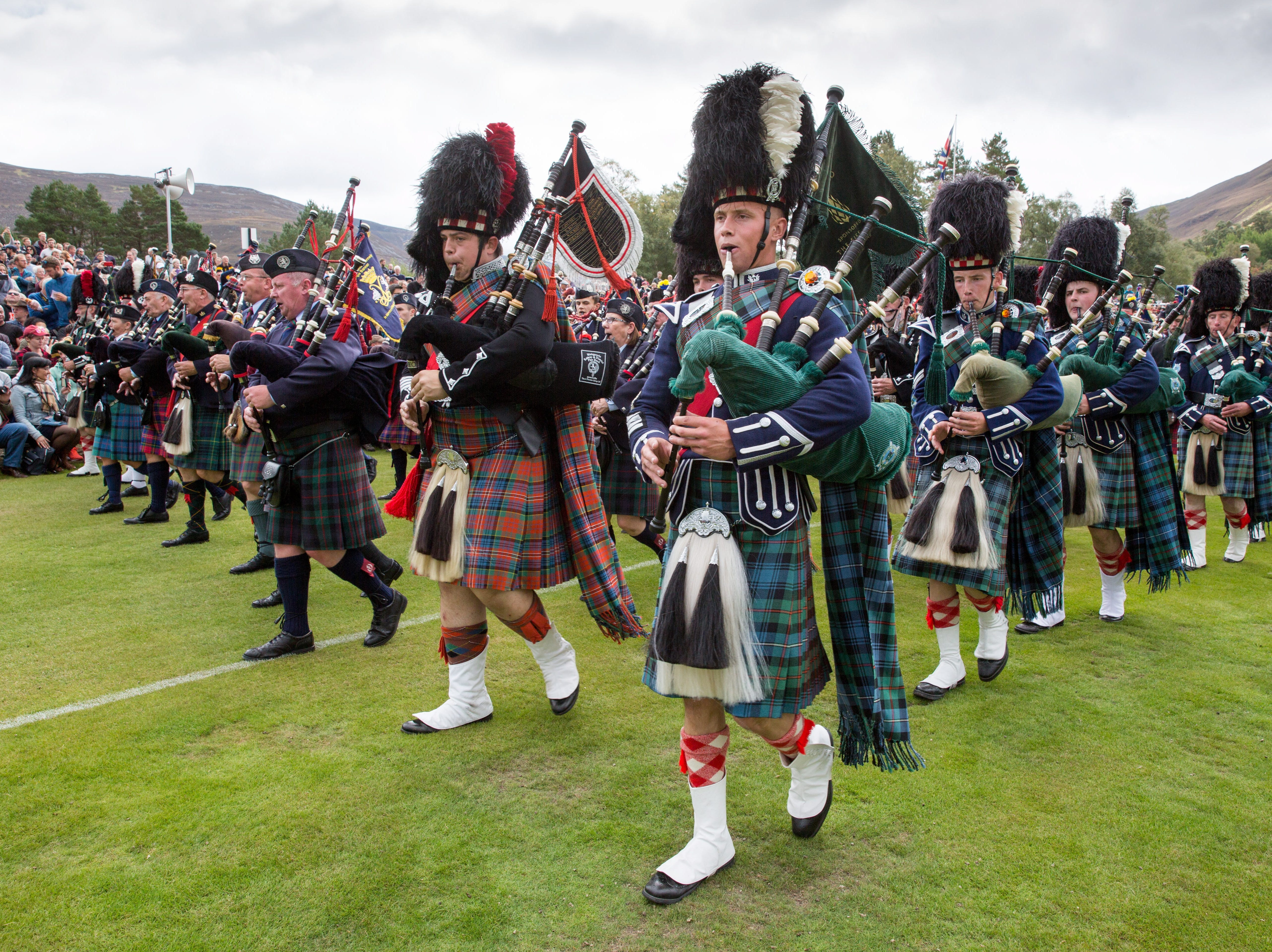 Pipe bands during the Braemar Gathering at The Princess Royal and Duke of Fife Memorial Park, in Braemar, Scotland on Sept. 1, 2018. The Braemar Gathering takes place annually on the first Saturday of the month of September.