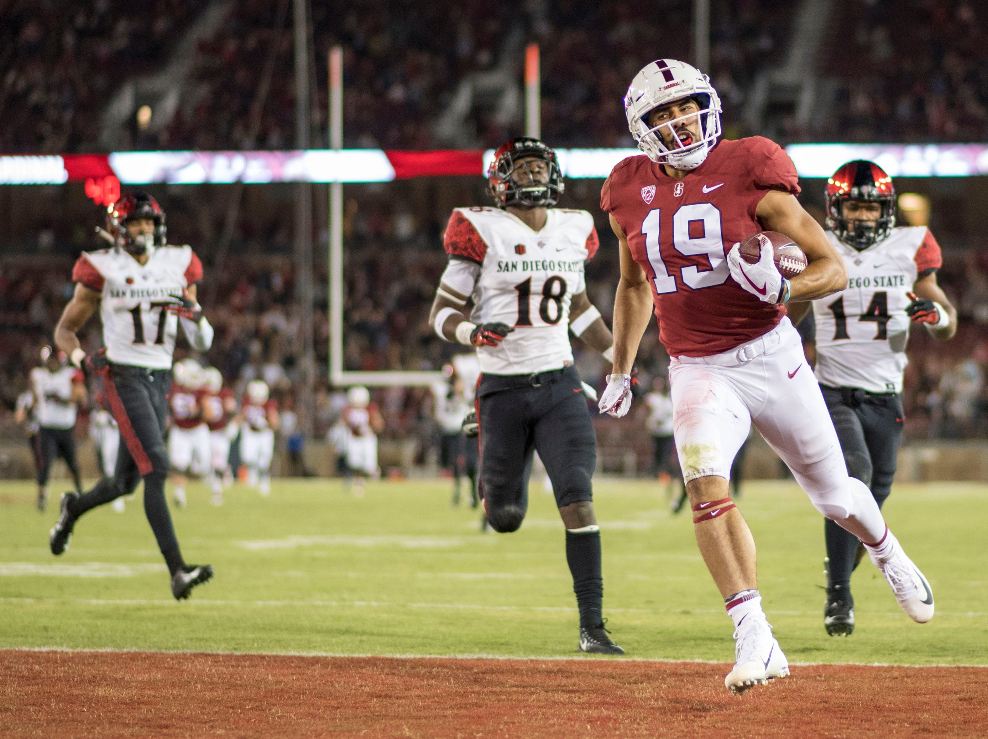 Stanford Cardinal wide receiver JJ Arcega-Whiteside (19) scores a touchdown against the San Diego State Aztecs during the third quarter at Stanford Stadium.