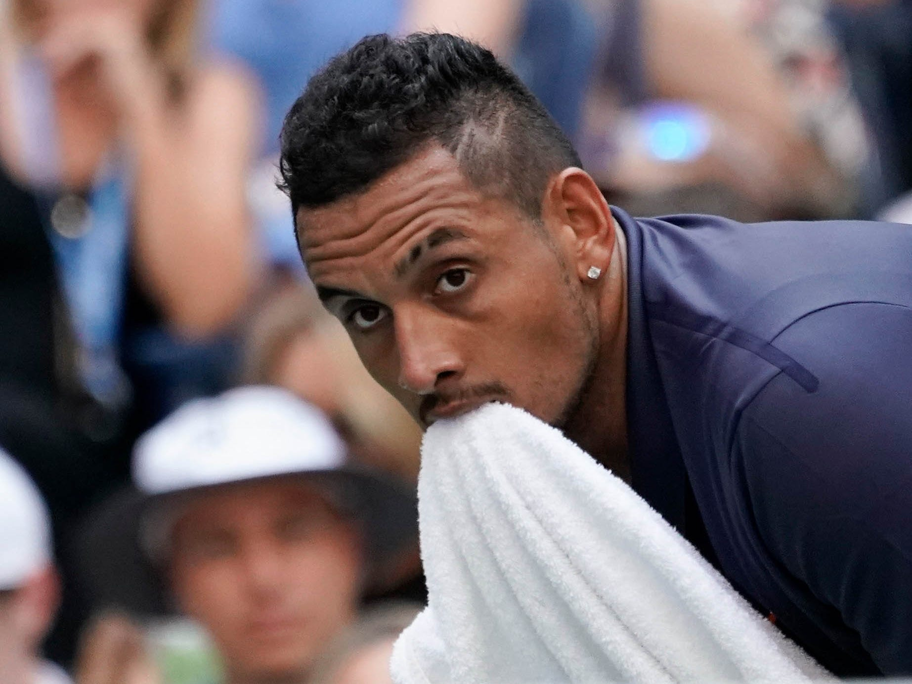 Nick Kyrgios drops a game in the third set against Roger Federer.