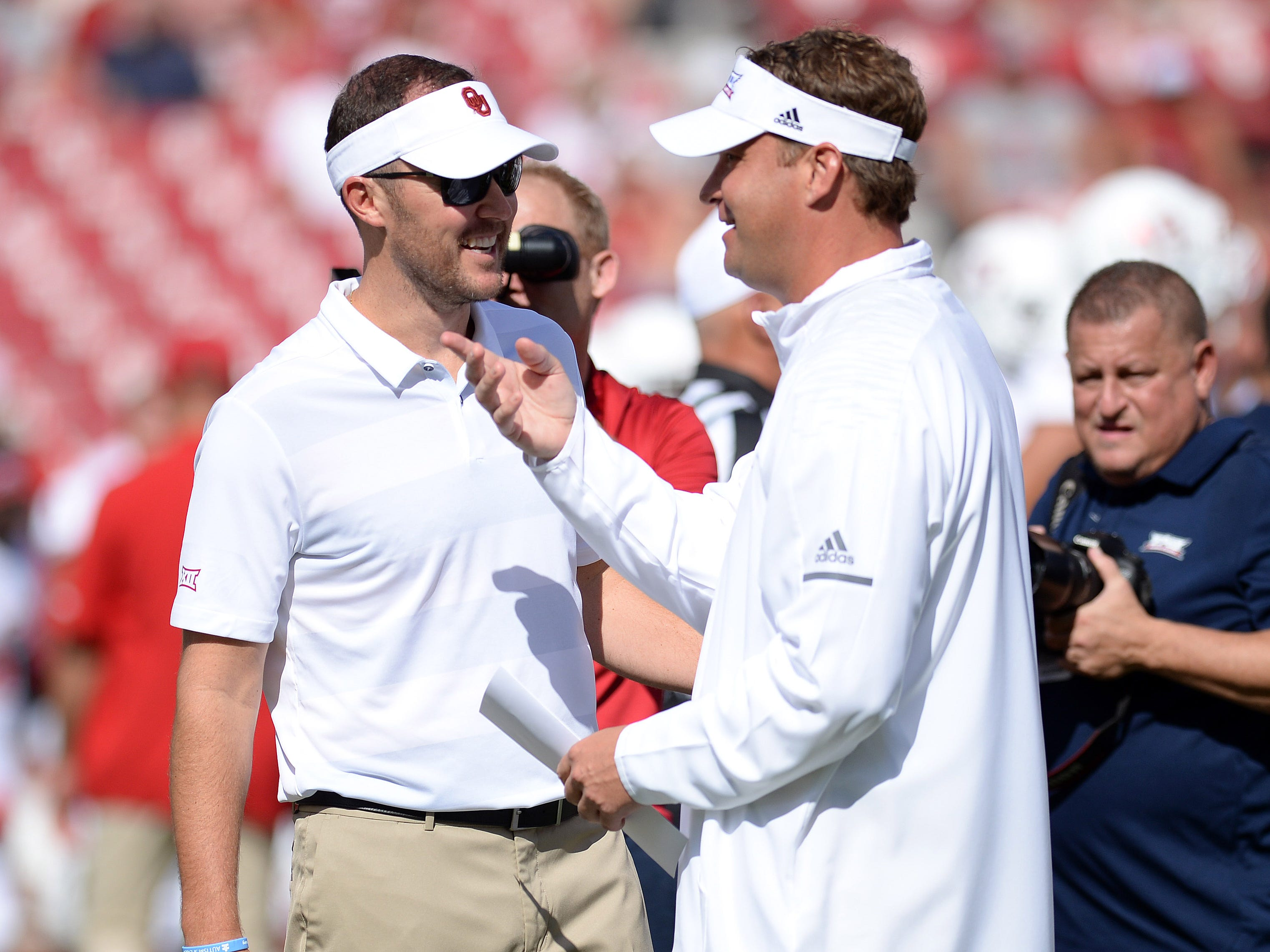 Oklahoma coach Lincoln Riley (left) greets Florida Atlantic coach Lane Kiffin pregame.