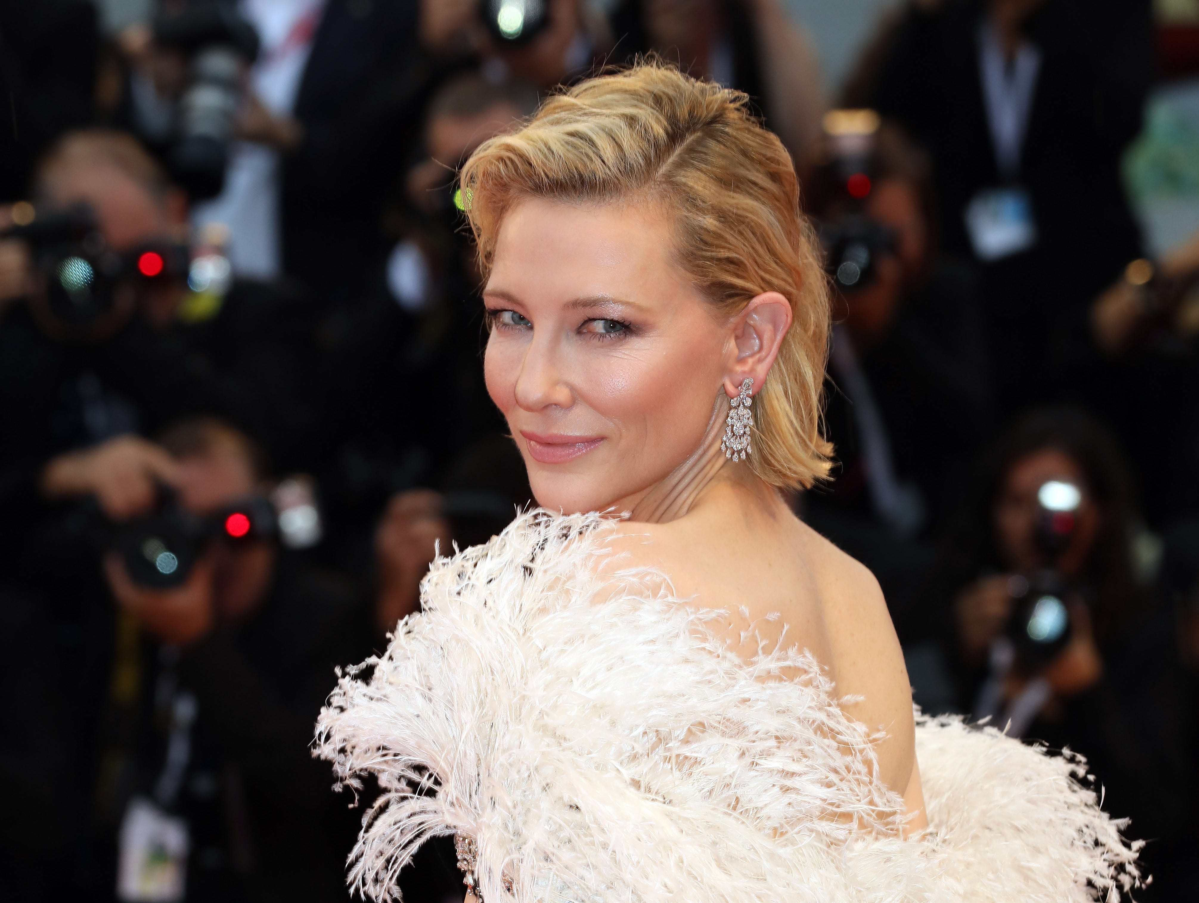 Cate Blanchett also stunned on the red carpet in a feathery ensemble.