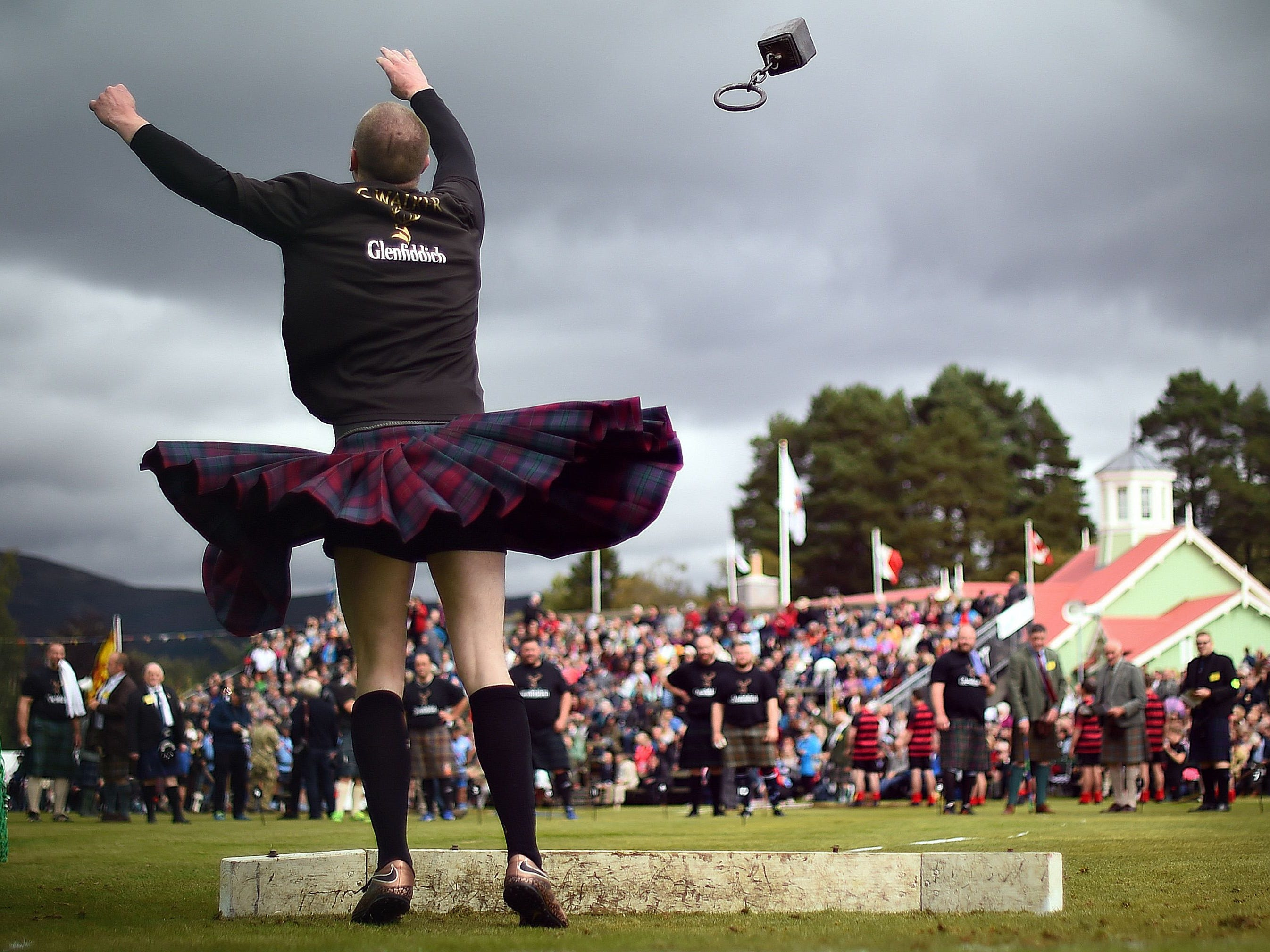 A competitor takes part in the Hammer Throw event at the annual Braemar Gathering in Braemar, central Scotland, on Sept. 1, 2018.