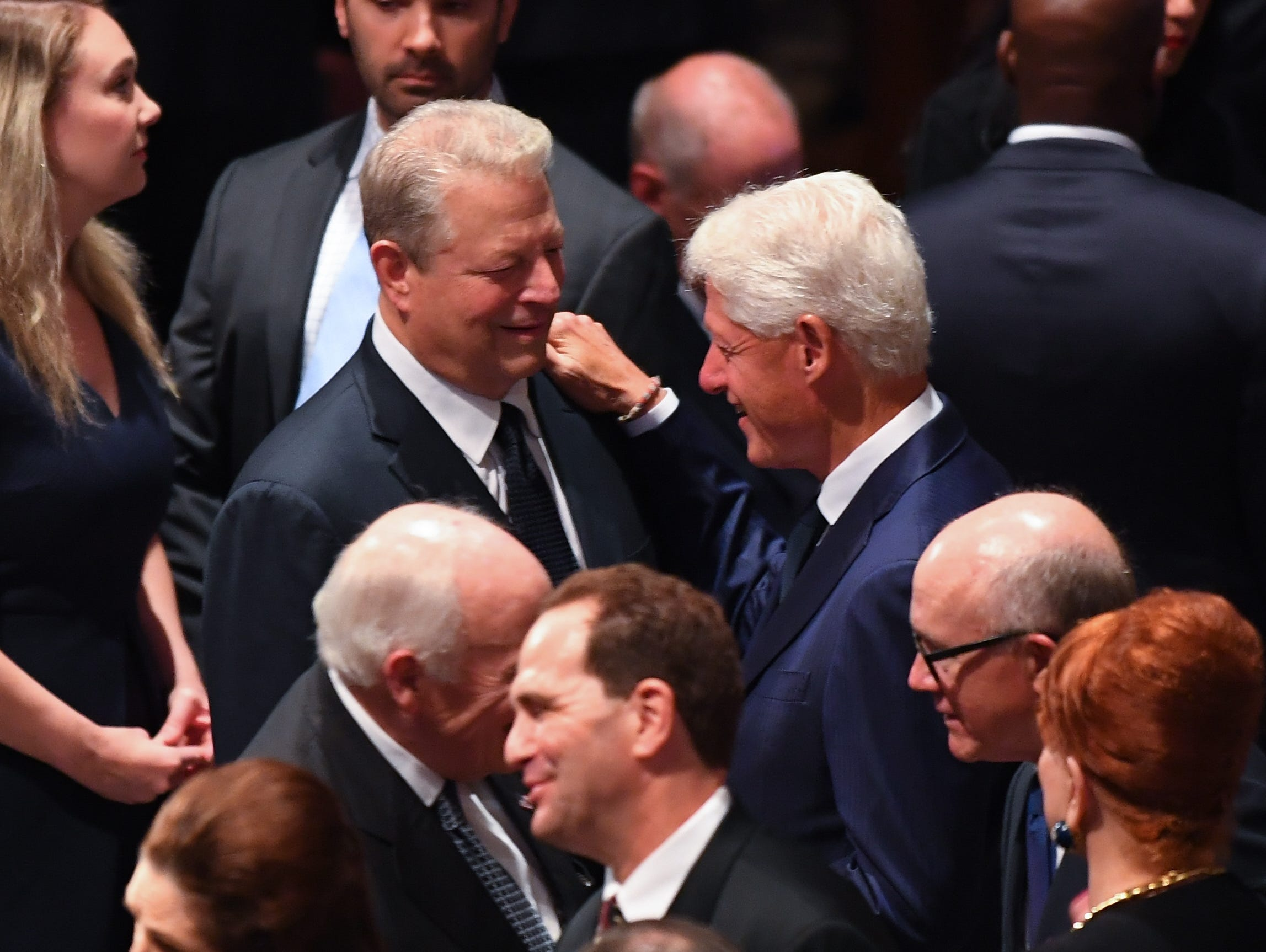 Former President Bill Clinton greets his former Vice President Al Gore at the memorial service for John McCain.